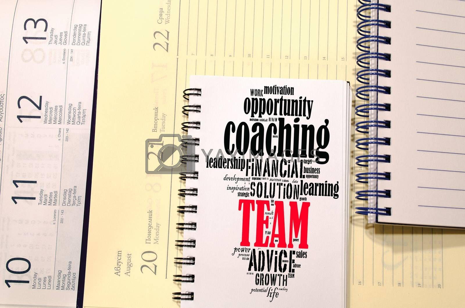 Team word cloud collage over notepad background