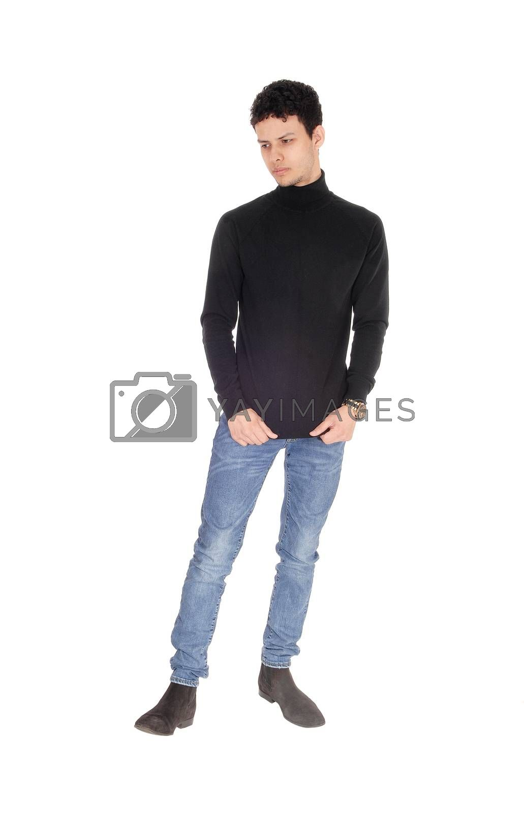 Tall young man standing with his hands in his pocket by feierabend