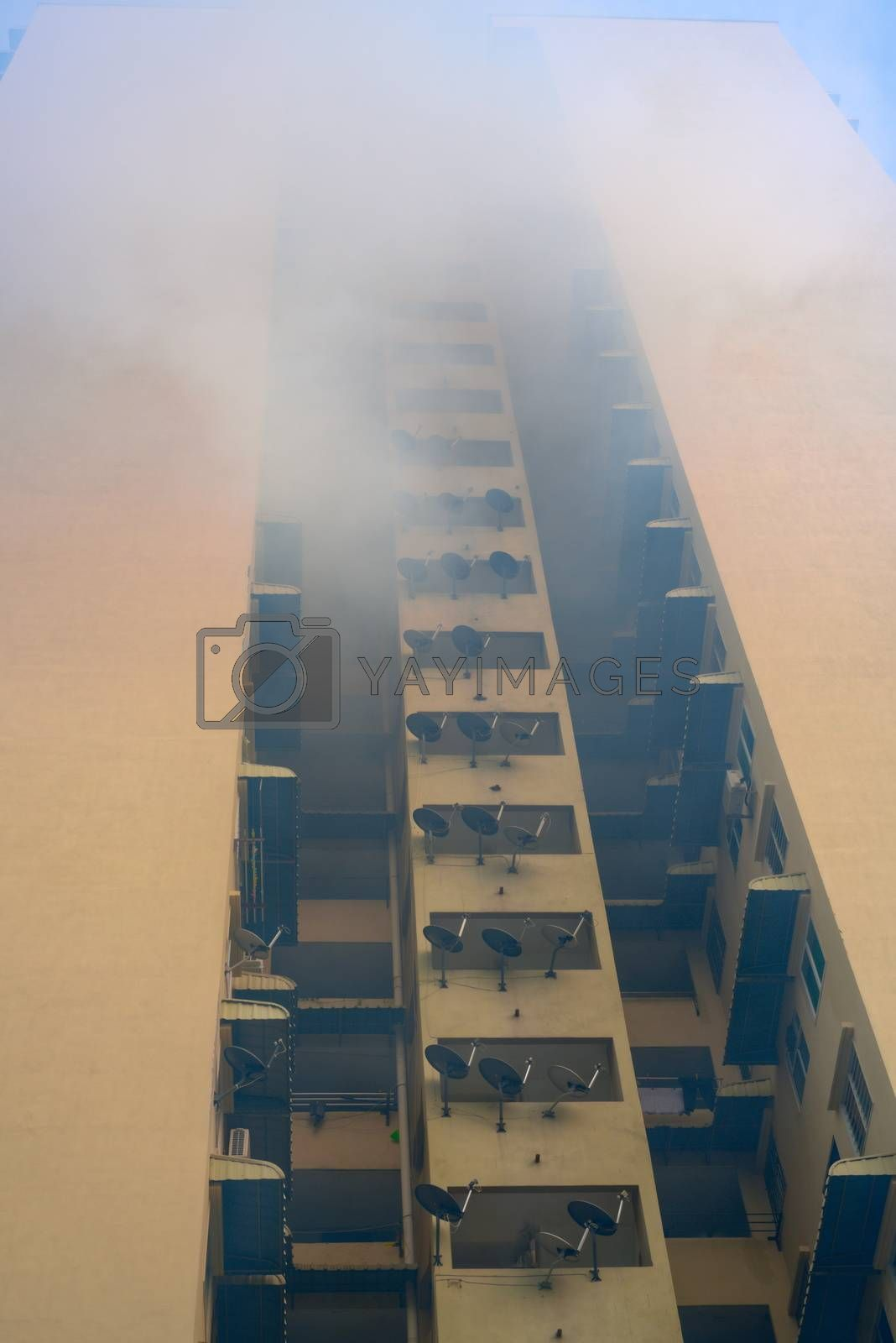 mosquito repellent fumigation on housing building high-rise blocks complex to avoid dengue - view from below