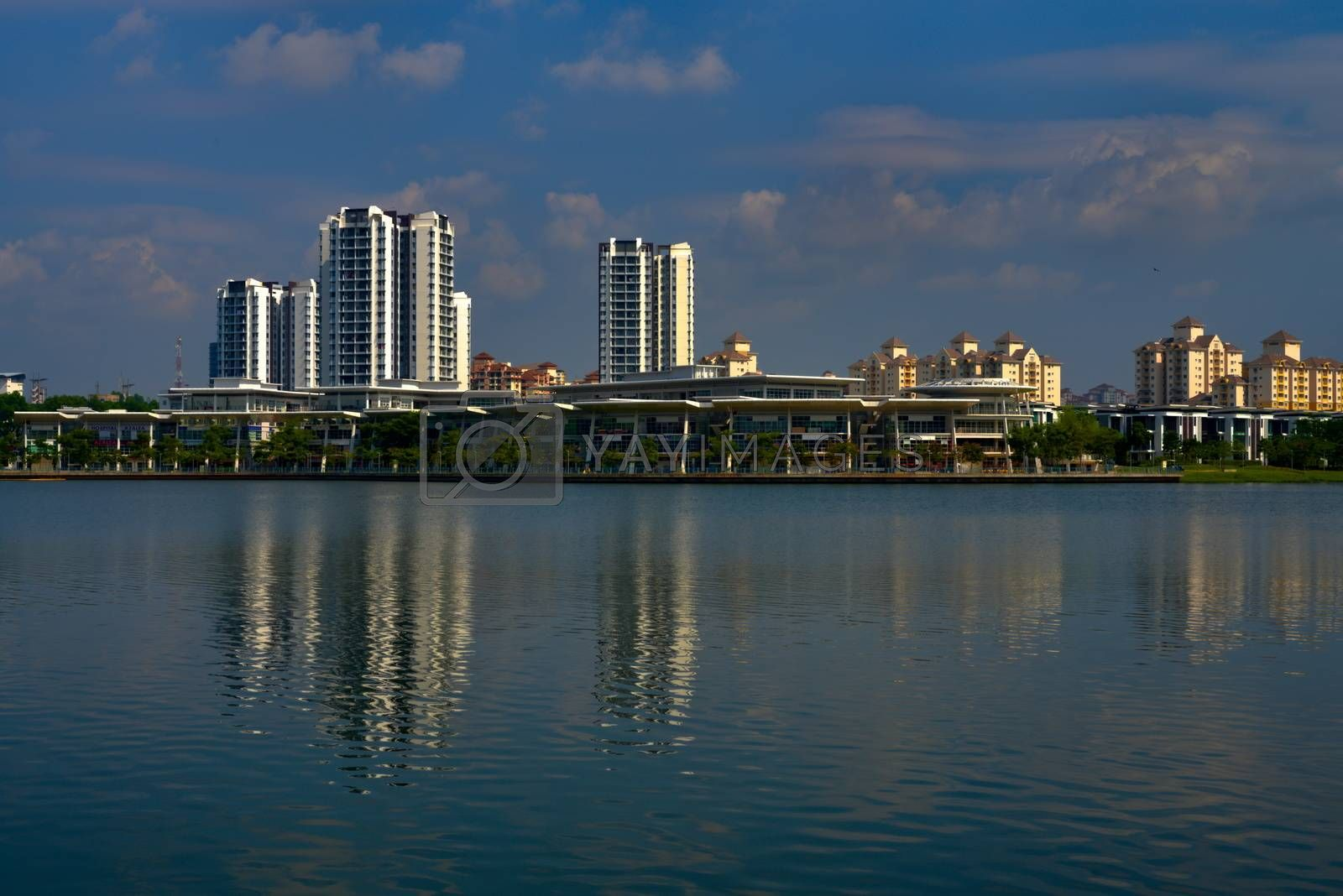 Putrajaya lake with residential area and skyscrapers