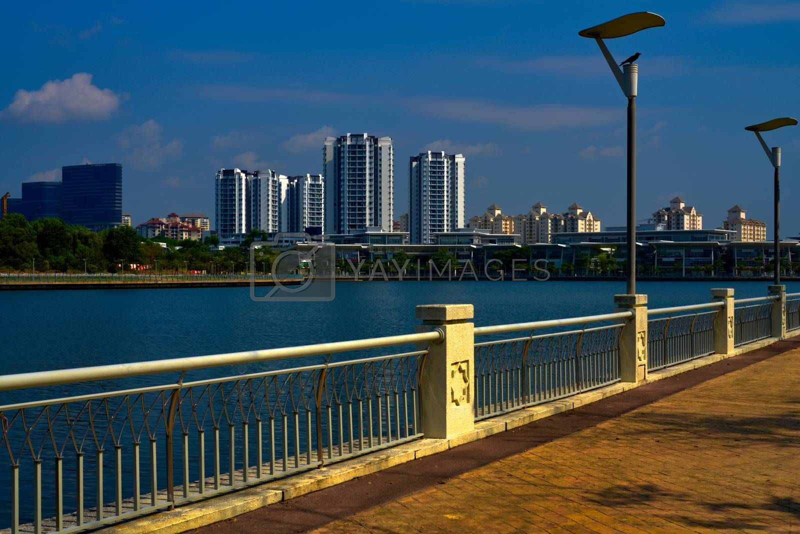 Putrajaya lake promenade with residential area and skyscrapers