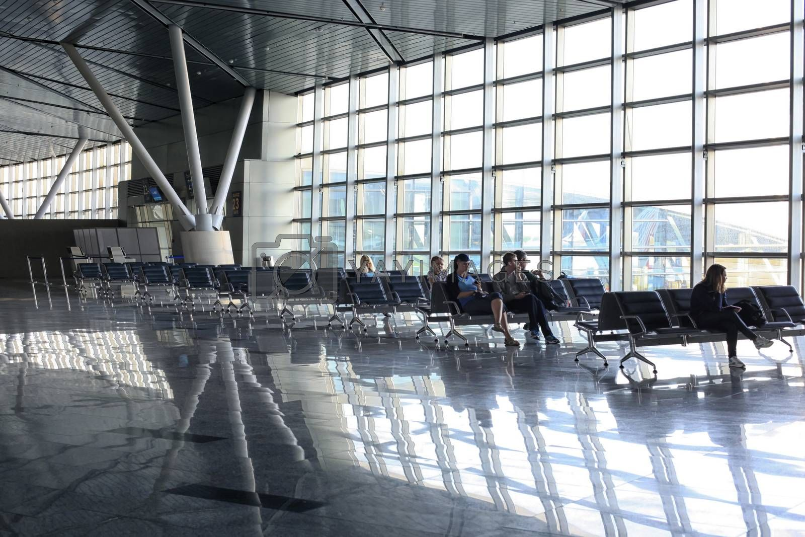 Moscow, Russia - August 13, 2013: People waiting for their flight at Vnukovo Airport, Moscow