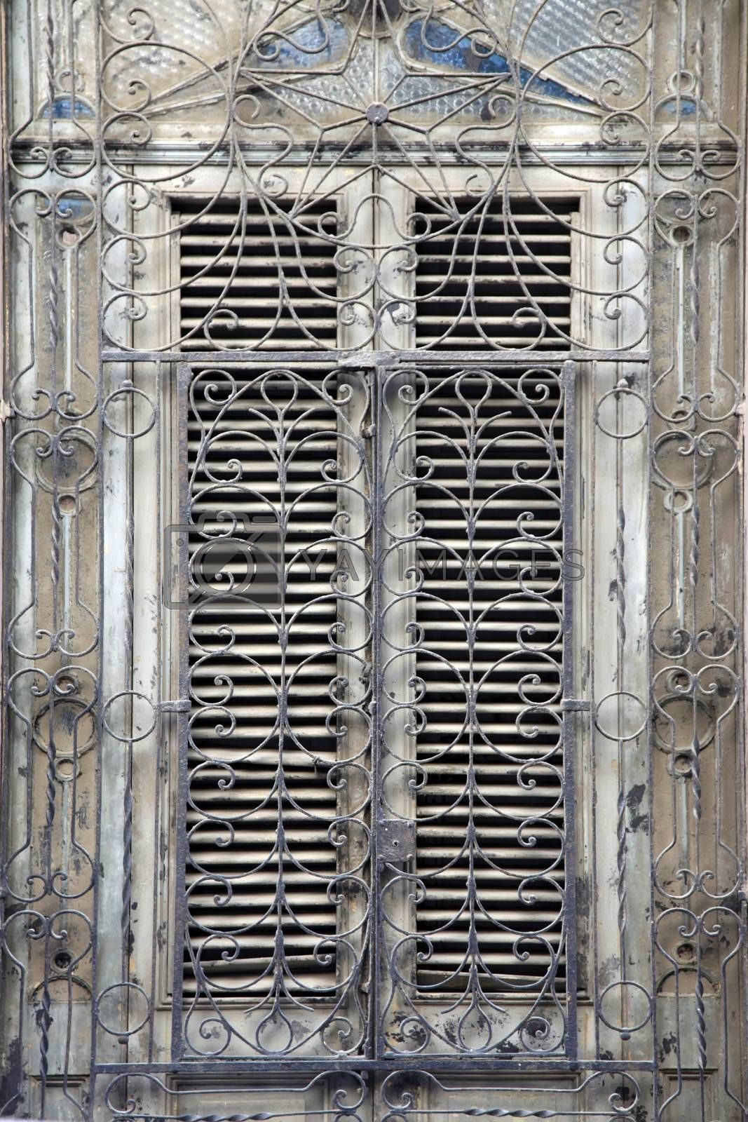 Wooden old window with iron bars