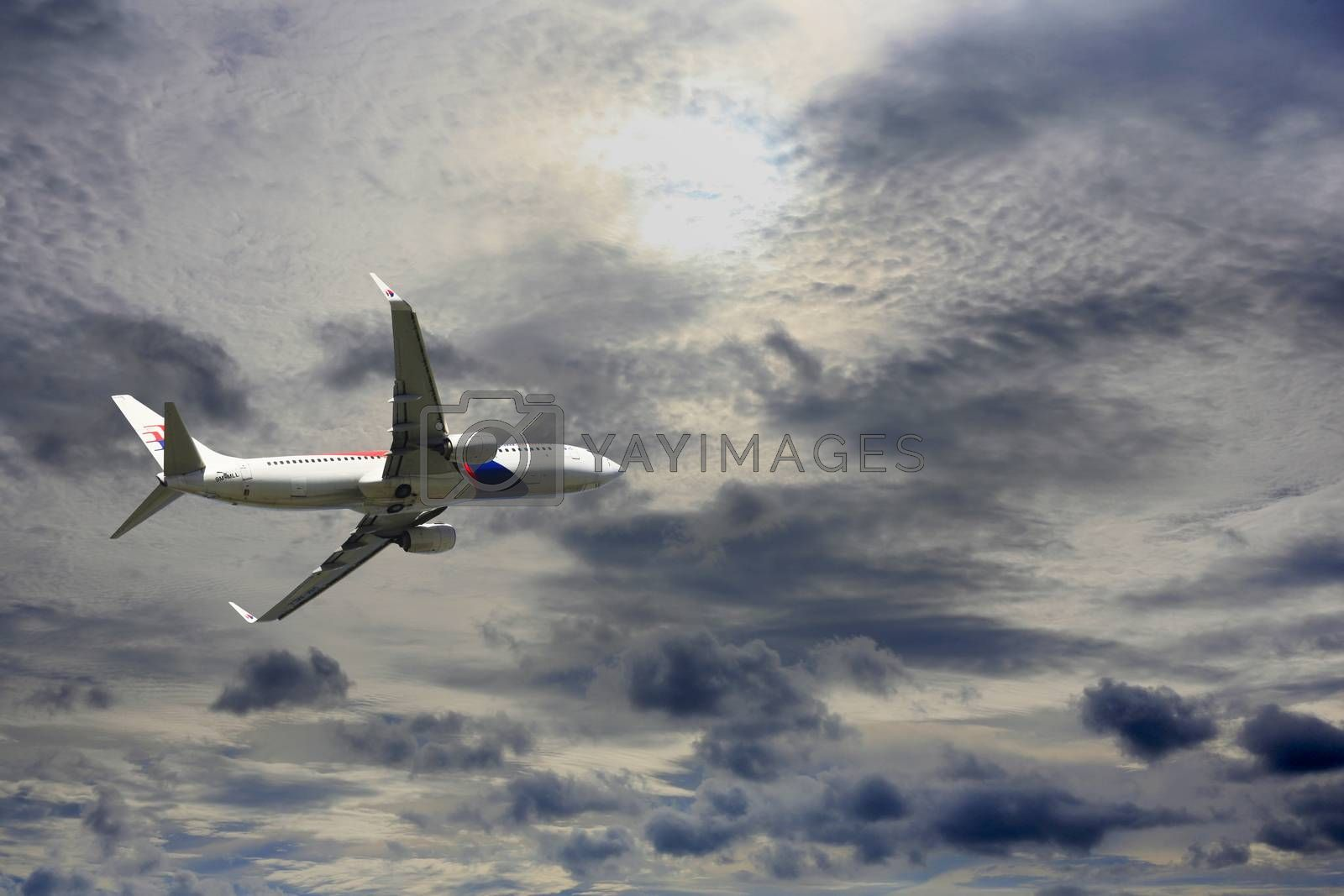 Kota Kinabalu, Malaysia - January 03, 2015: Passenger airplane Boeing 737-4H6 flying travel, trip at flight level over the white clouds