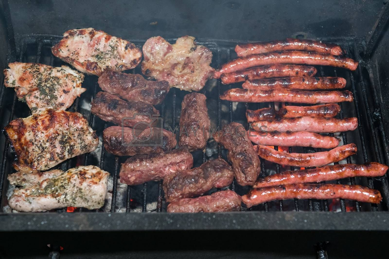 Grilled meats outdoors by Dan Totilca