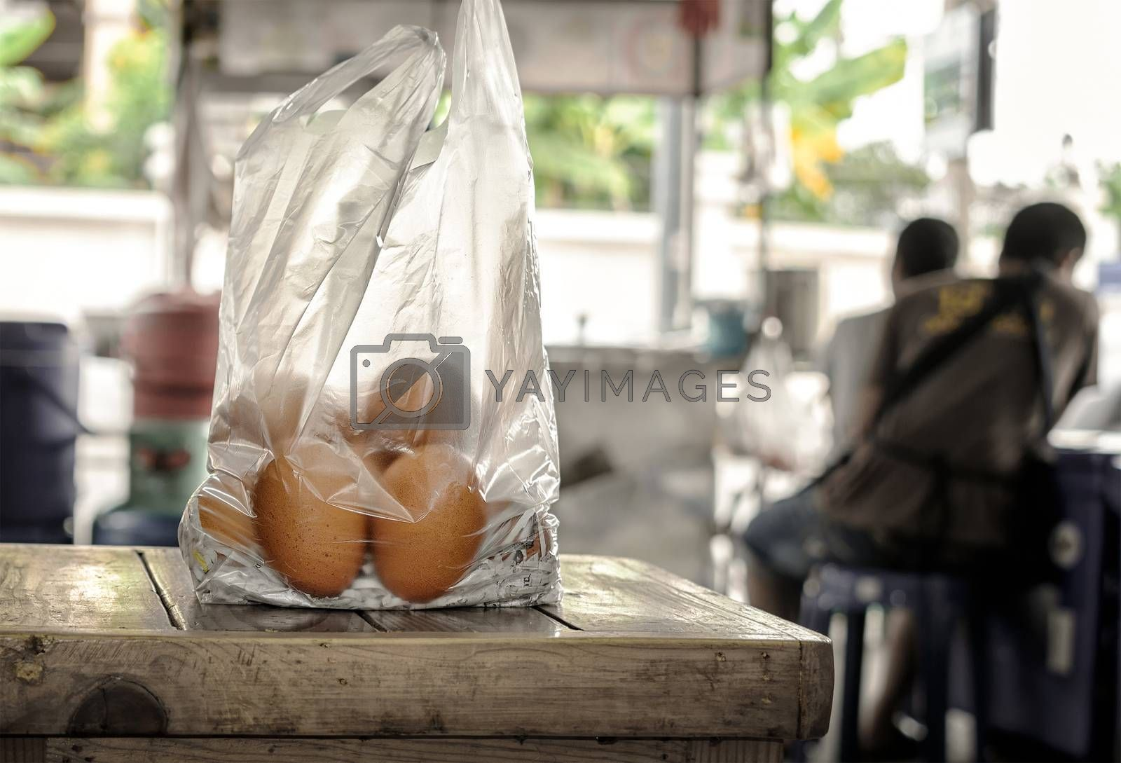 Fresh just Purchased Organic Brown Chicken Eggs in a Plastic Bag