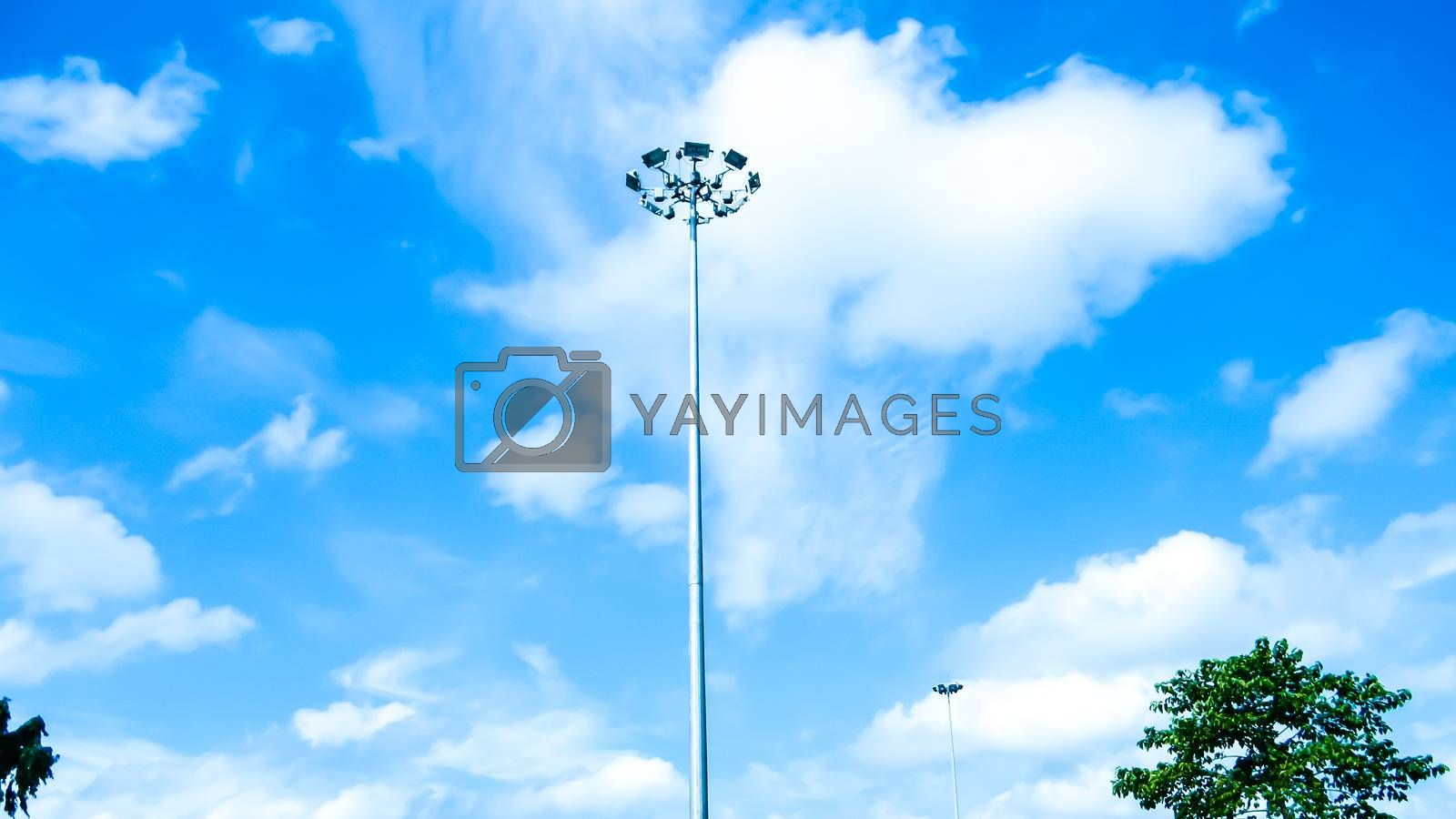 Street Public lighting pole against a blue sky and cloud background. by SB Stock