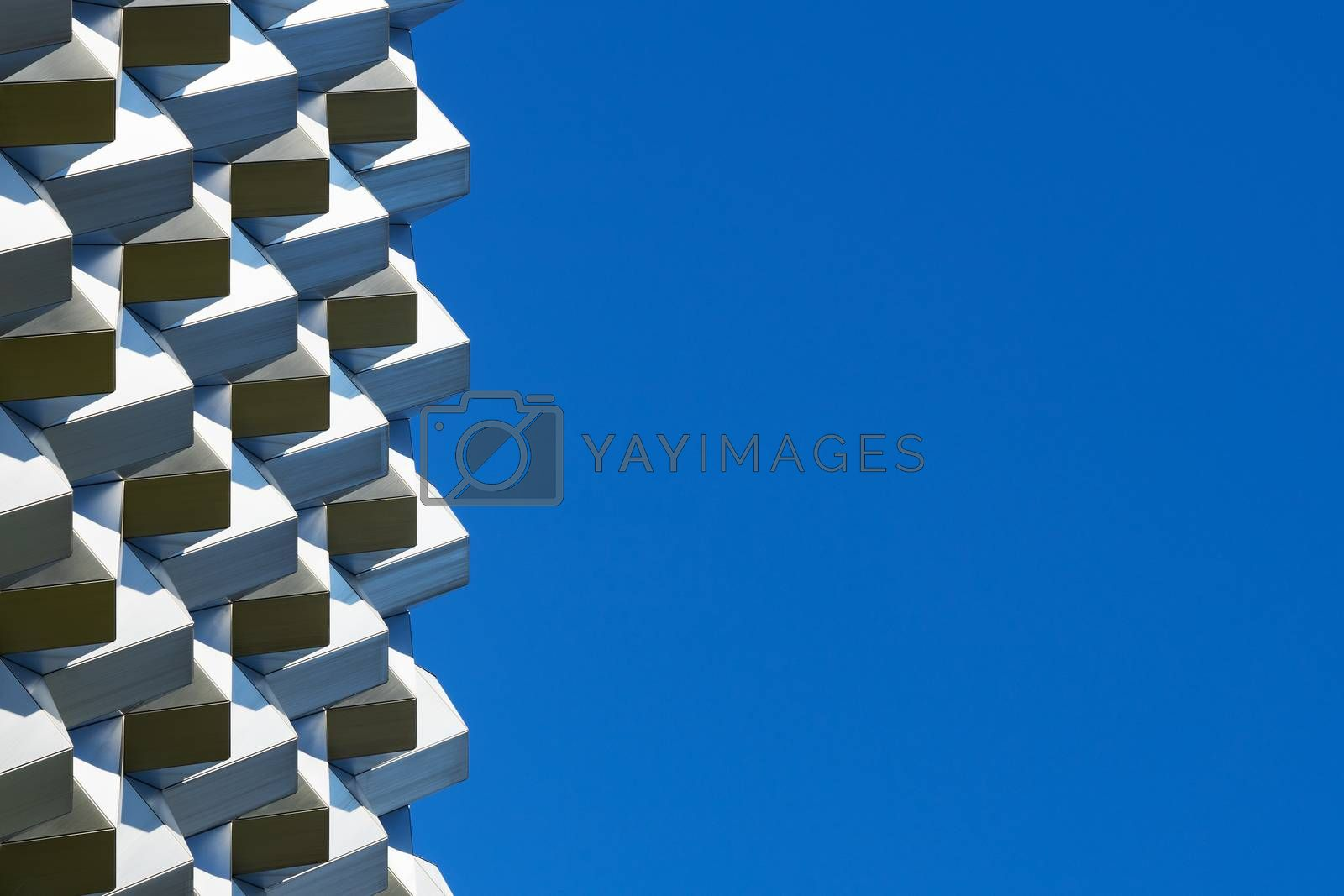 Roof structure seen against the clear blue sky on a sunny day.