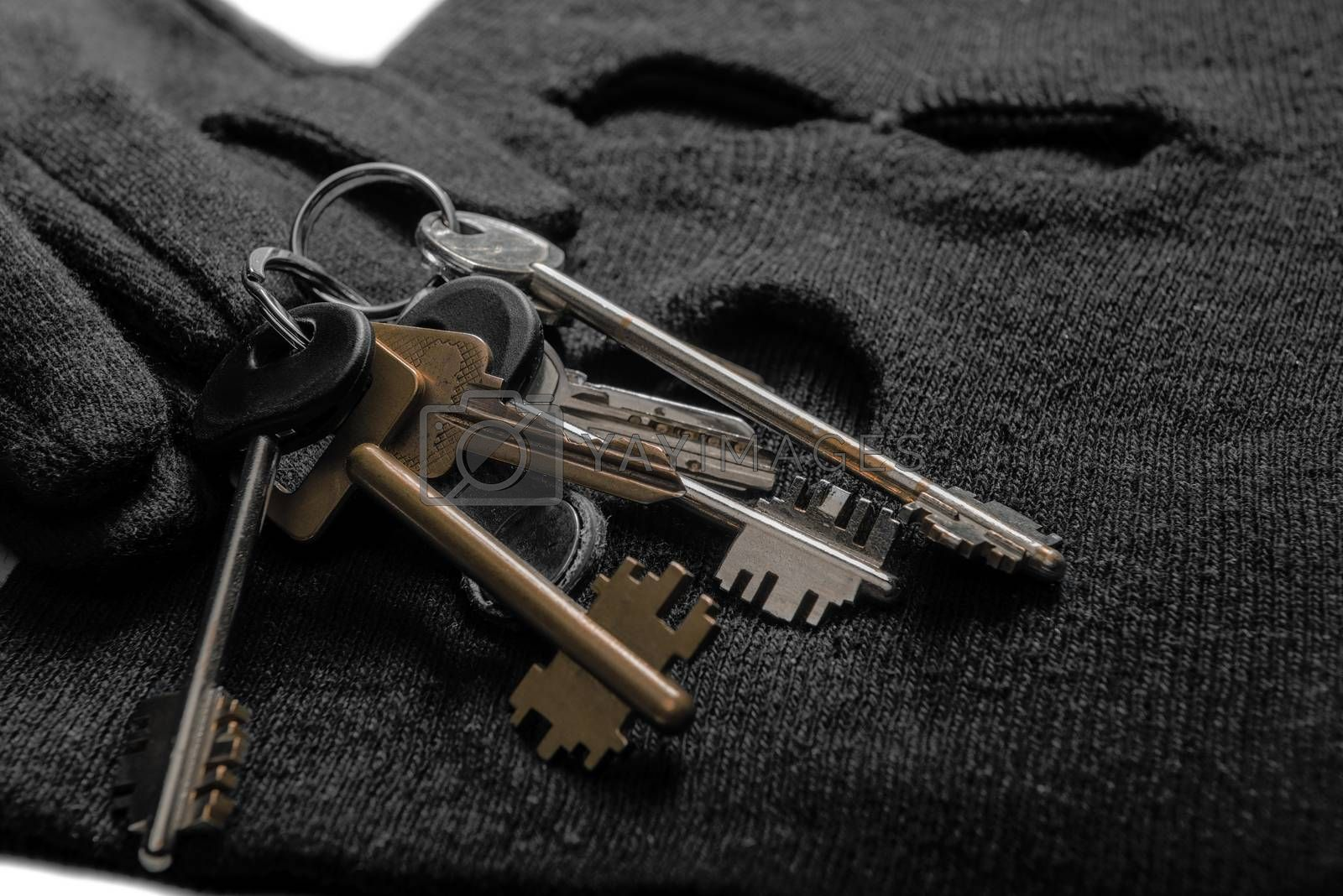 keys of the robber for opening locks, balaclava and gloves close by Labunskiy K.