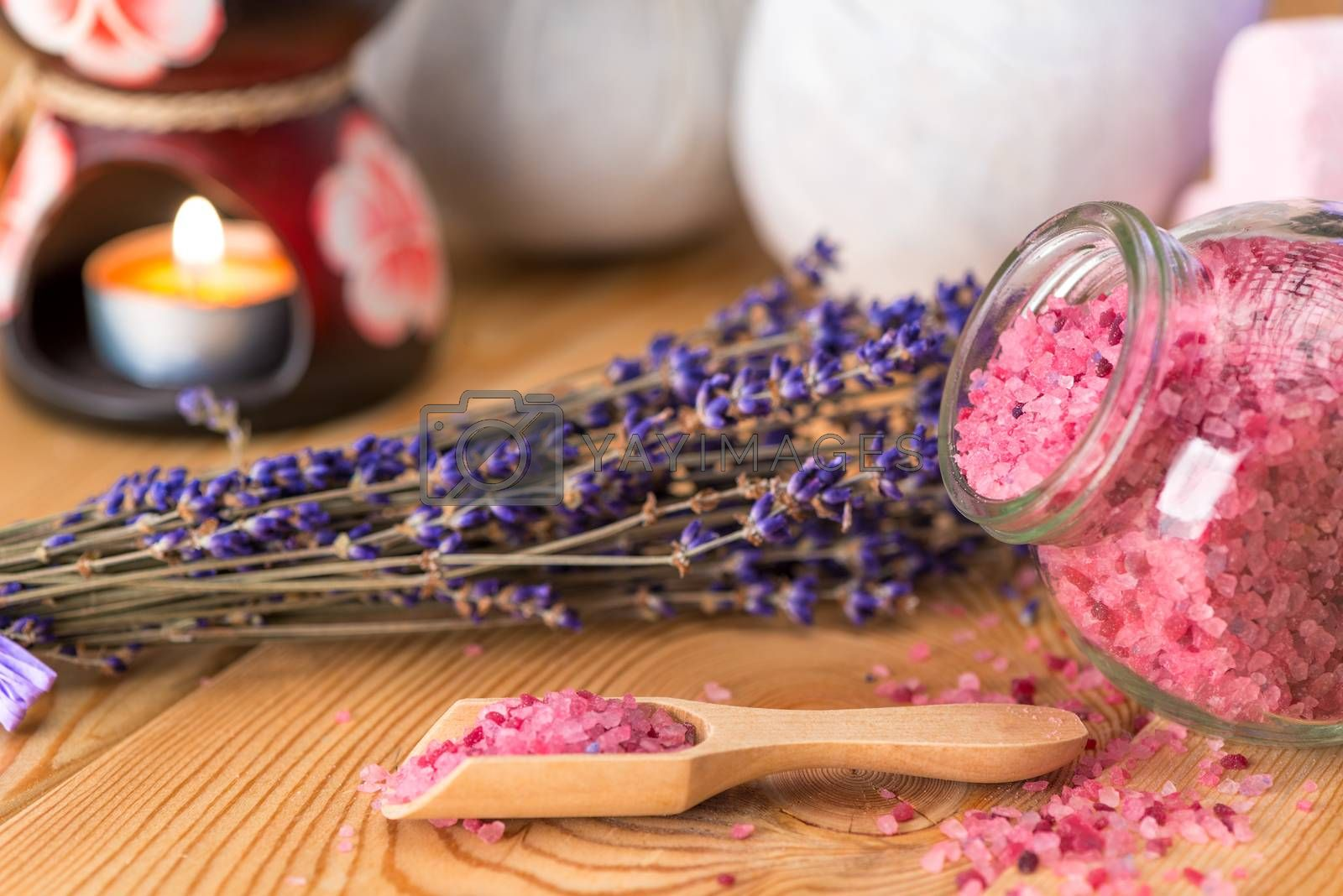 sea salt in a wooden spoon with natural lavender oil and a bunch by Labunskiy K.