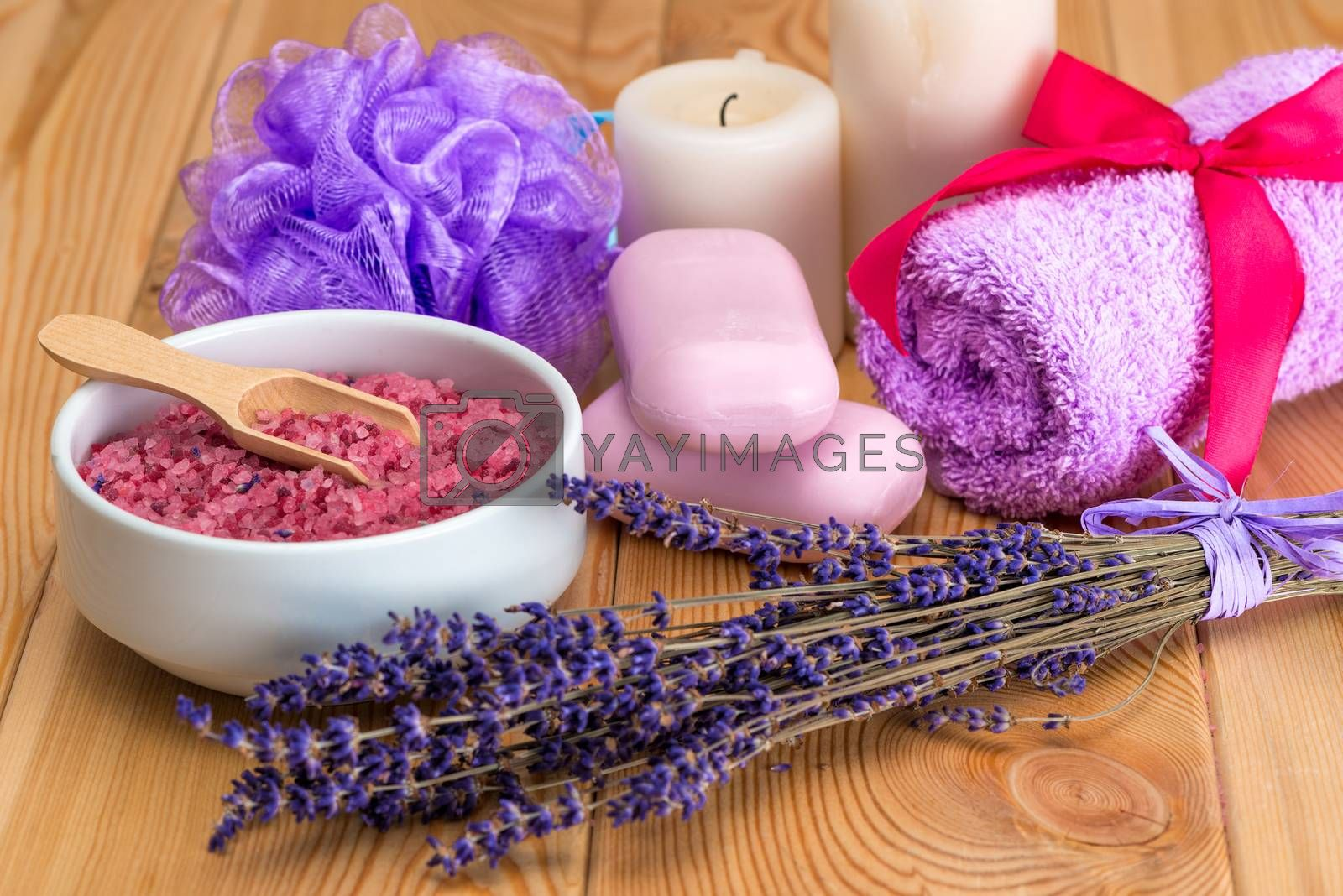 bunch of dried lavender flowers, pink soap and sea salt with lav by Labunskiy K.