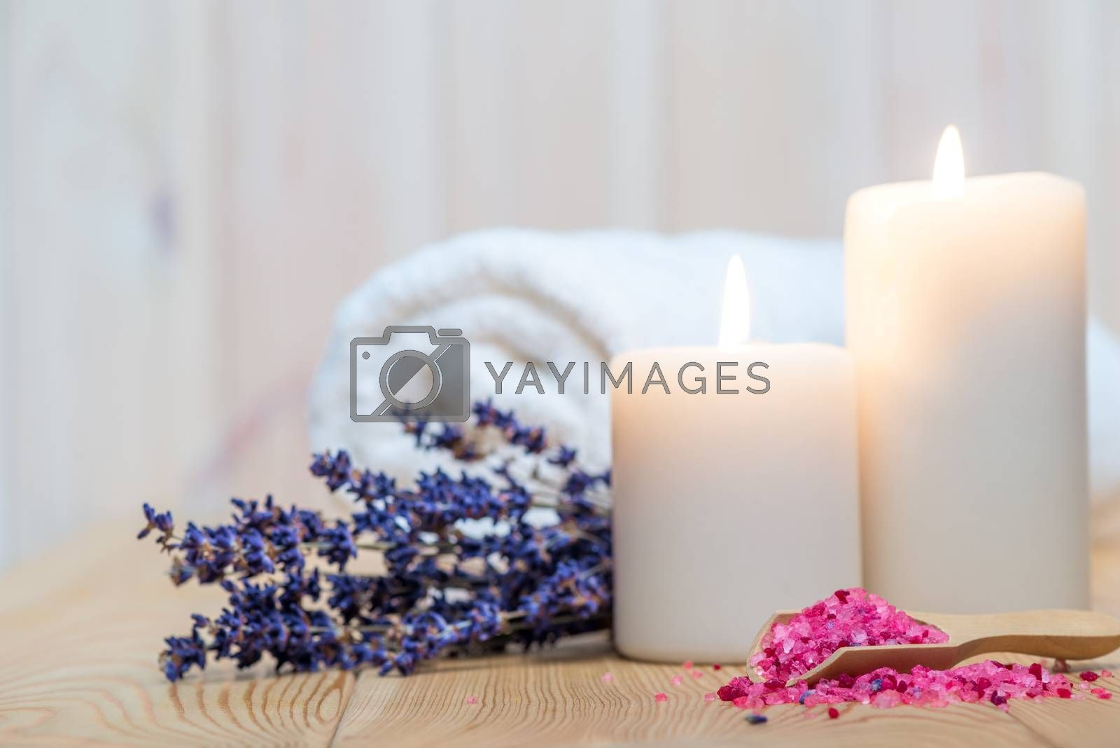 closeup of sea salt with lavender and burning candles spa proced by Labunskiy K.