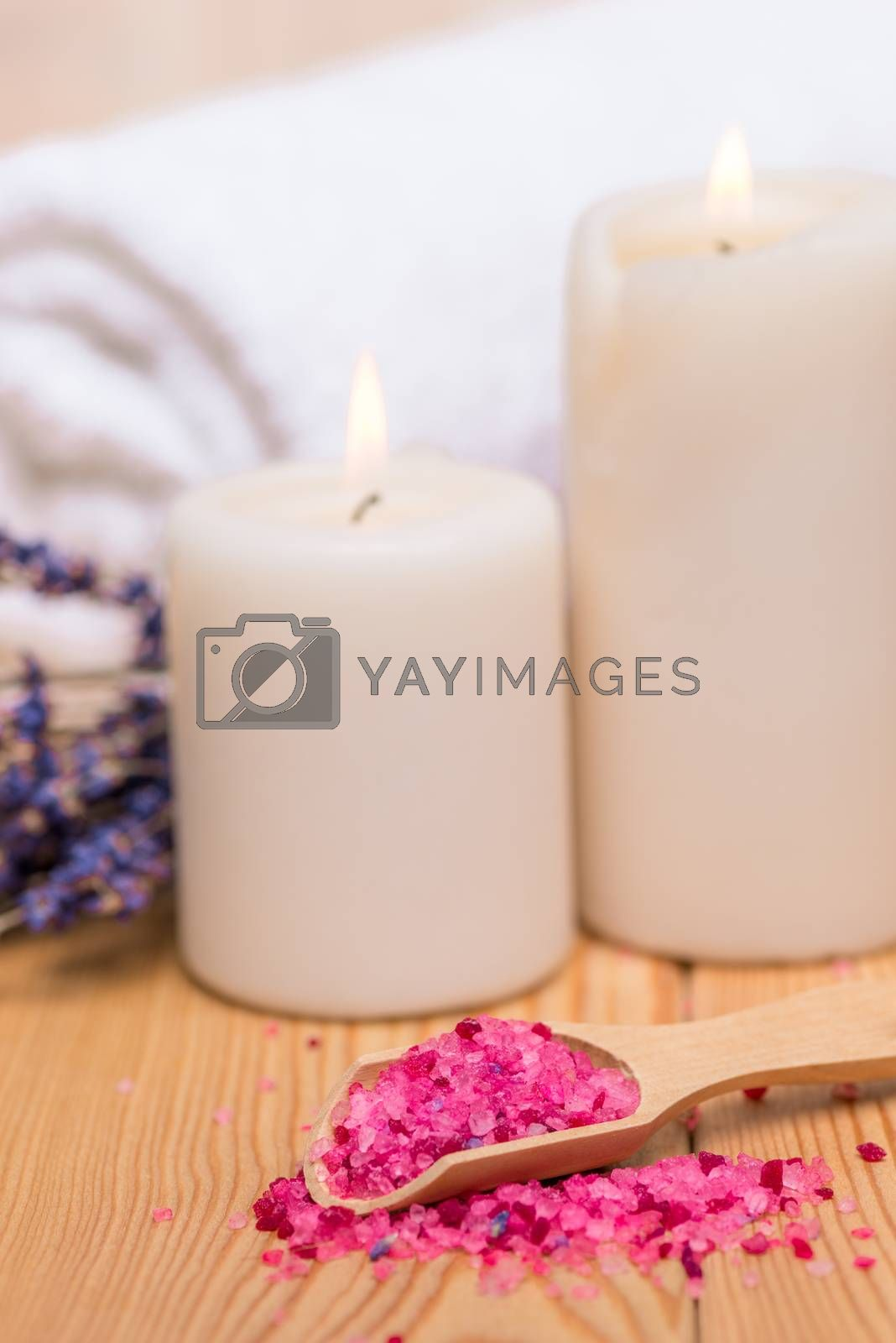 close up sea salt in wooden spoon and burning candles soothing s by Labunskiy K.