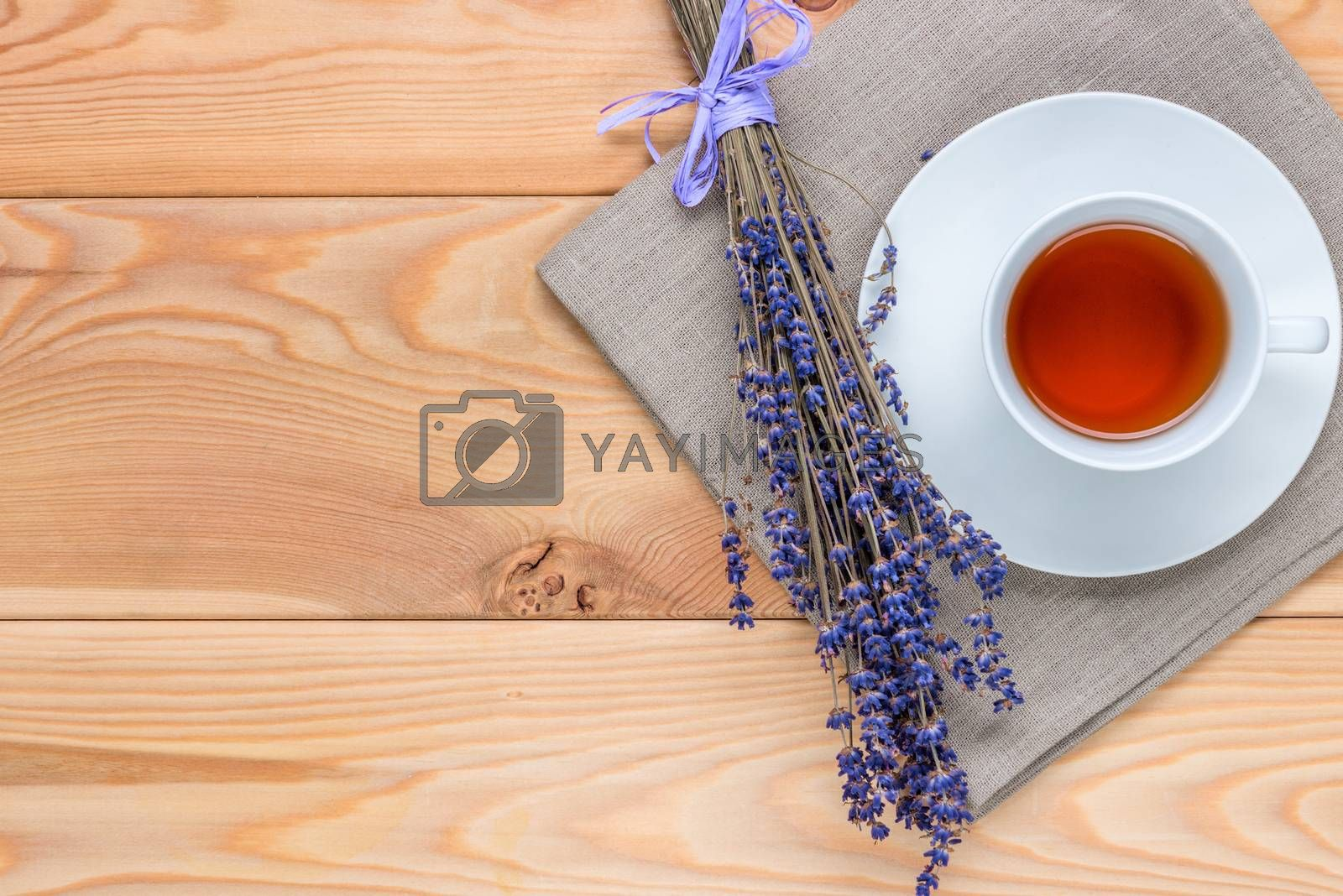 top view cup of soothing tea with lavender and a bunch of flower by Labunskiy K.