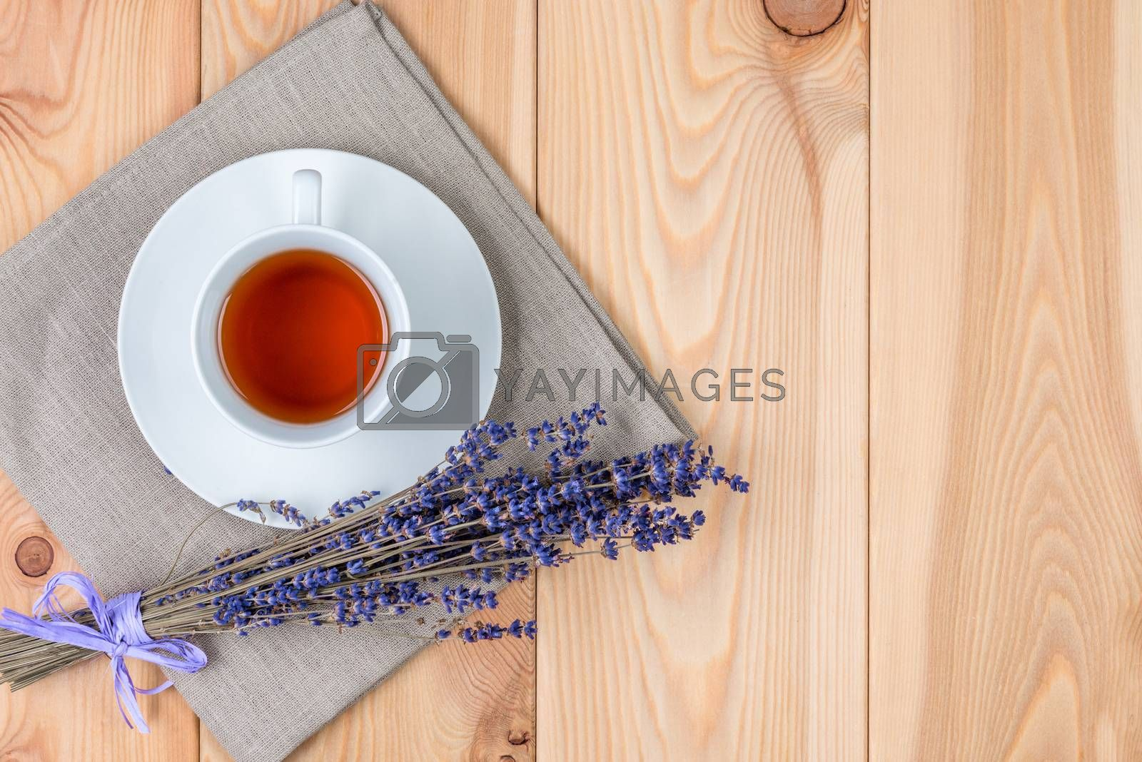 a cup of soothing tea with lavender and a bunch of flowers on a  by Labunskiy K.
