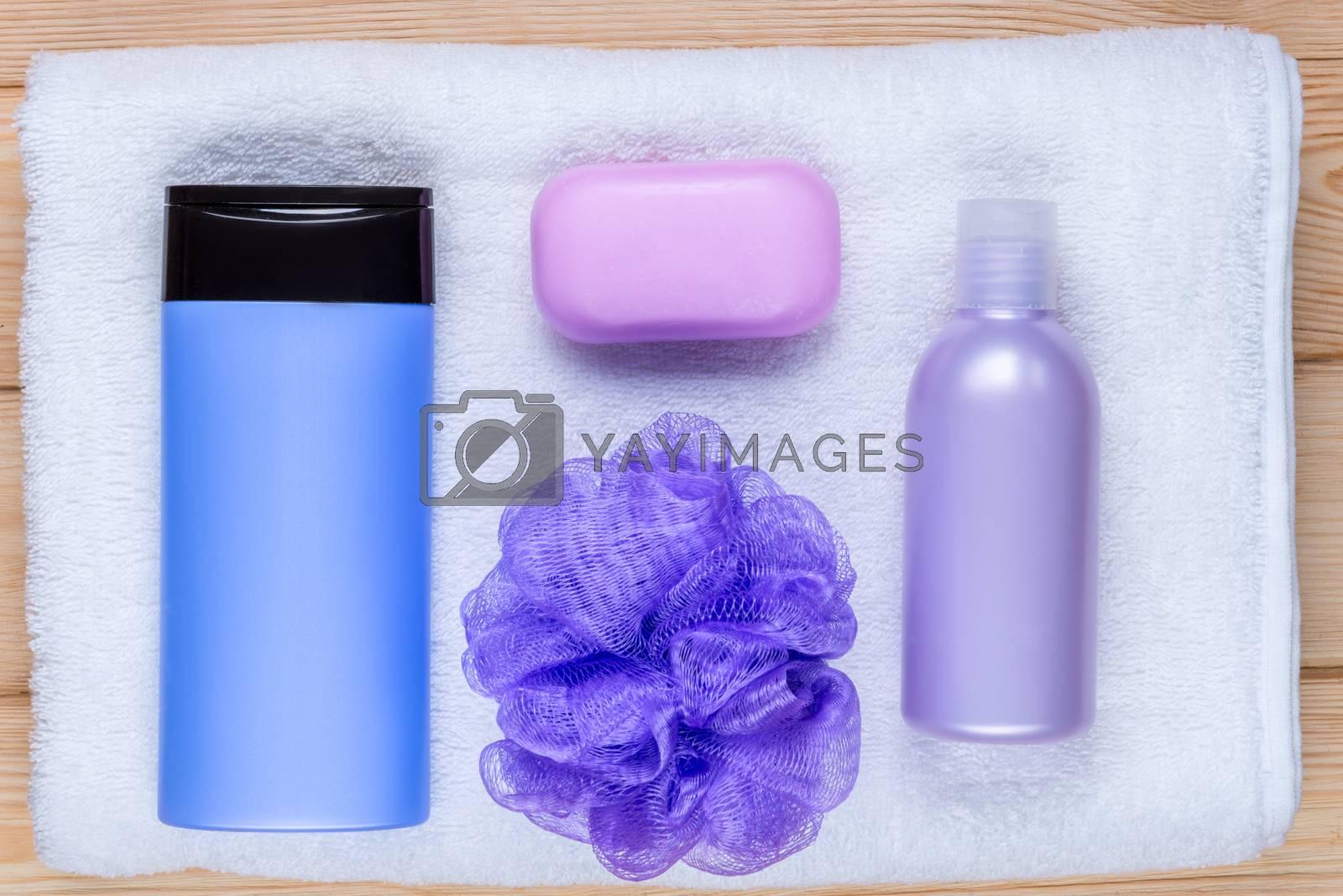 bath cosmetics on a terry towel top view by Labunskiy K.