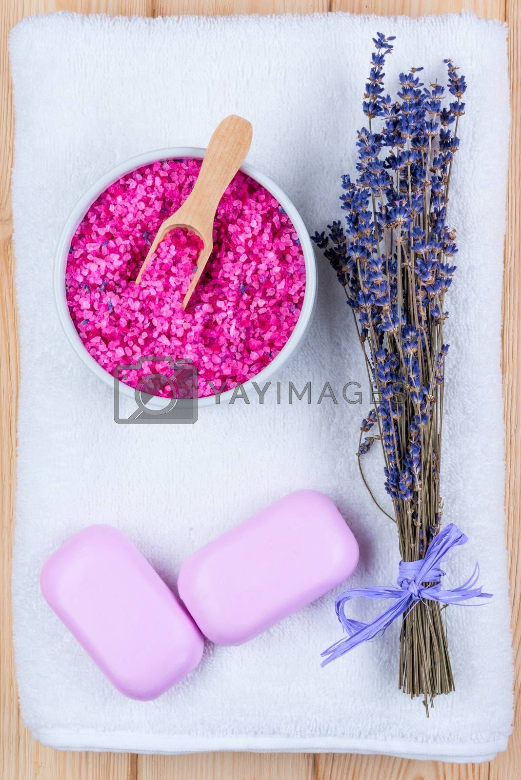 dried lavender on a white terry towel, sea salt and two bars of  by Labunskiy K.