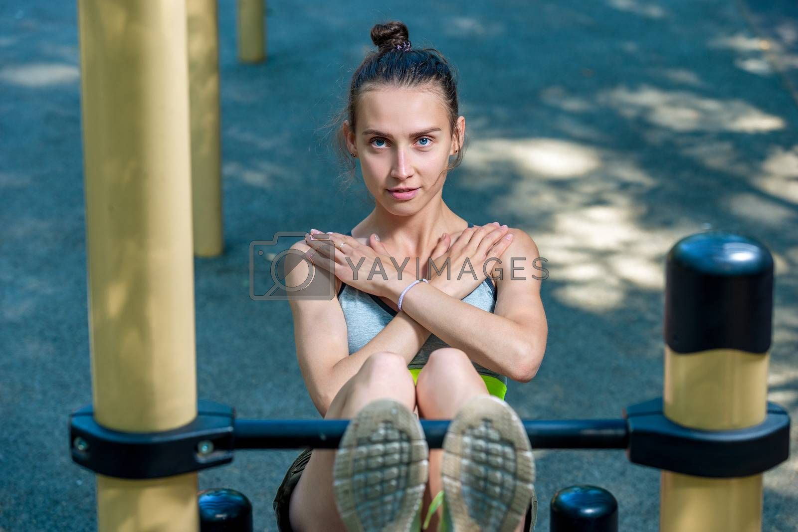 beautiful sports woman on the sports field shakes the press, exe by Labunskiy K.