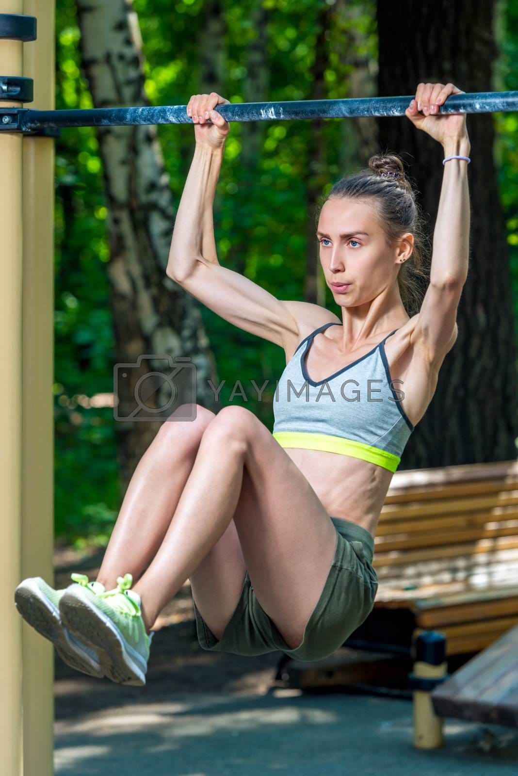 sports woman on the playground doing press exercises by Labunskiy K.