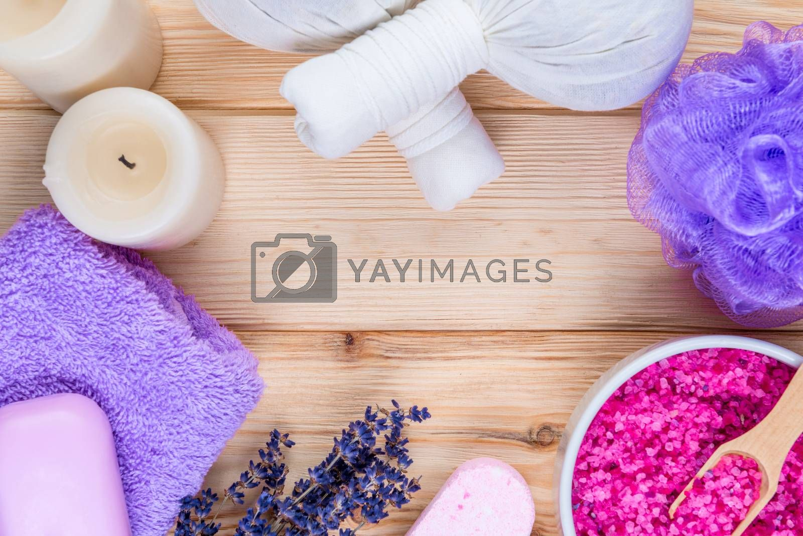 on wooden boards, herbal massage bags with lavender, cosmetic pr by Labunskiy K.
