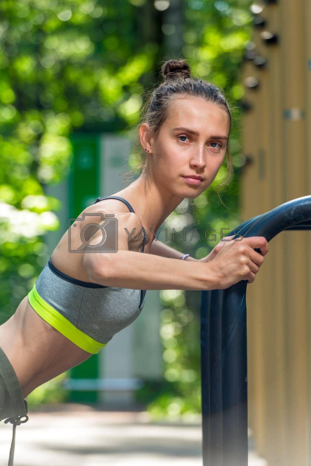 closeup portrait of a female athlete with a sports figure exerci by Labunskiy K.