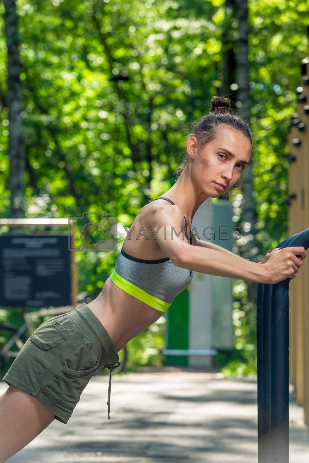 in the summer park training on simulators, portrait of a strong  by Labunskiy K.