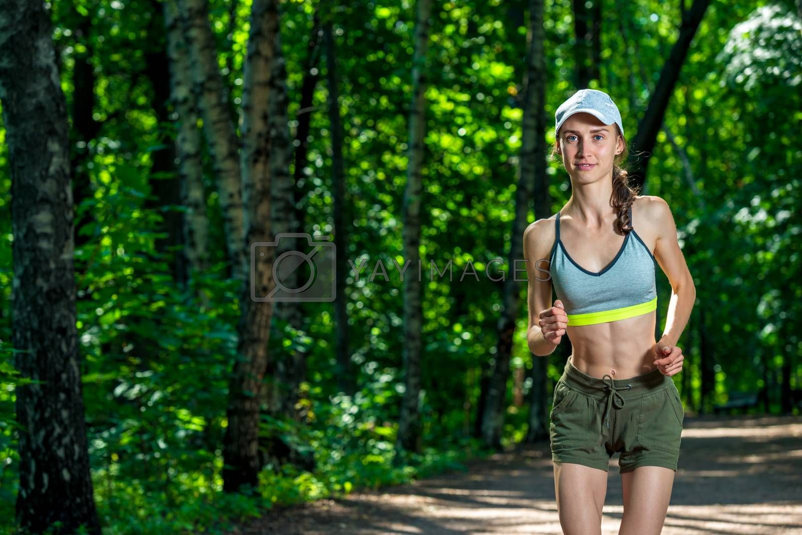 portrait of a female runner in a summer park by Labunskiy K.