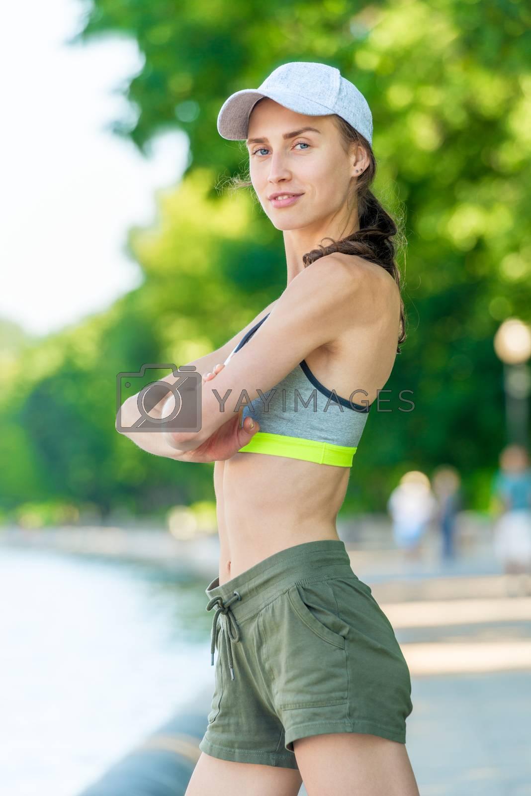 sporty girl posing closeup on city embankment by Labunskiy K.