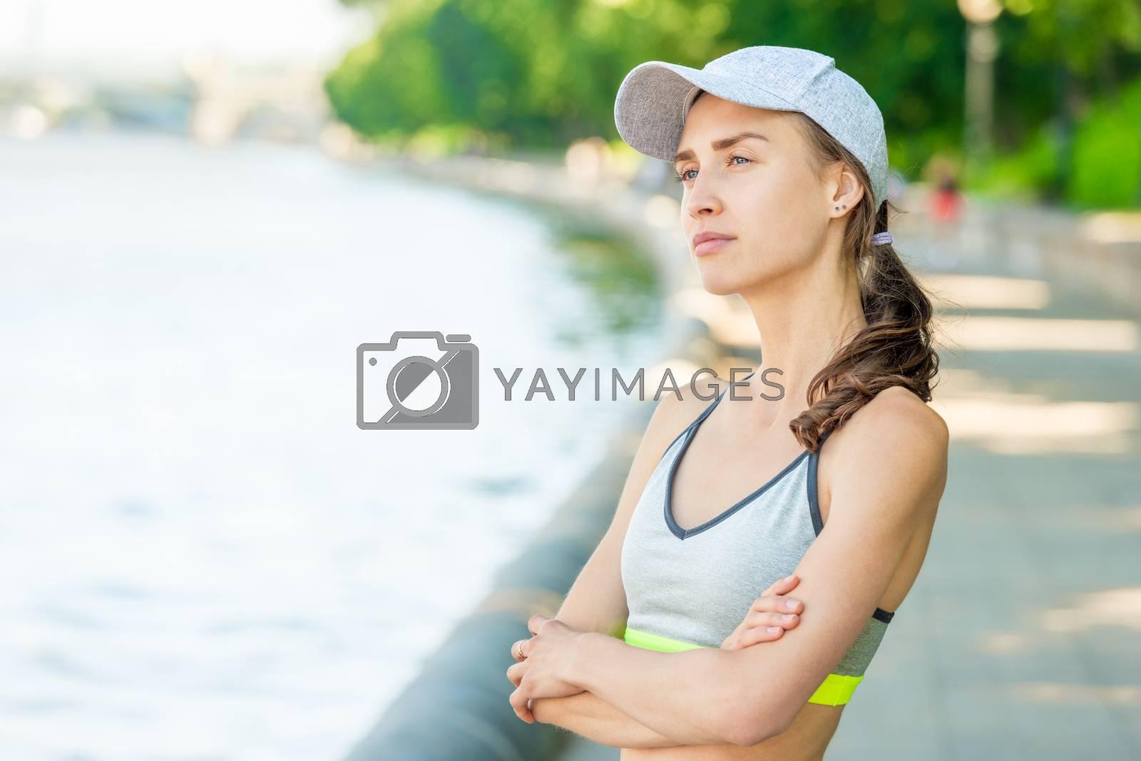 Vertical close-up portrait of a dreamy sportswoman who is posing by Labunskiy K.