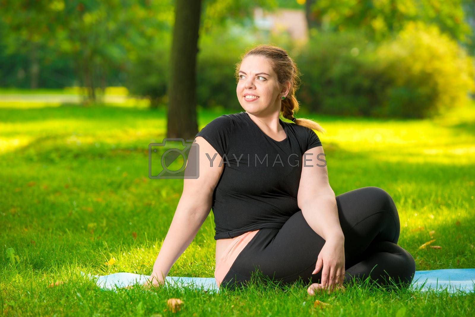 portrait of a plus size model in the park during a yoga class, s by Labunskiy K.