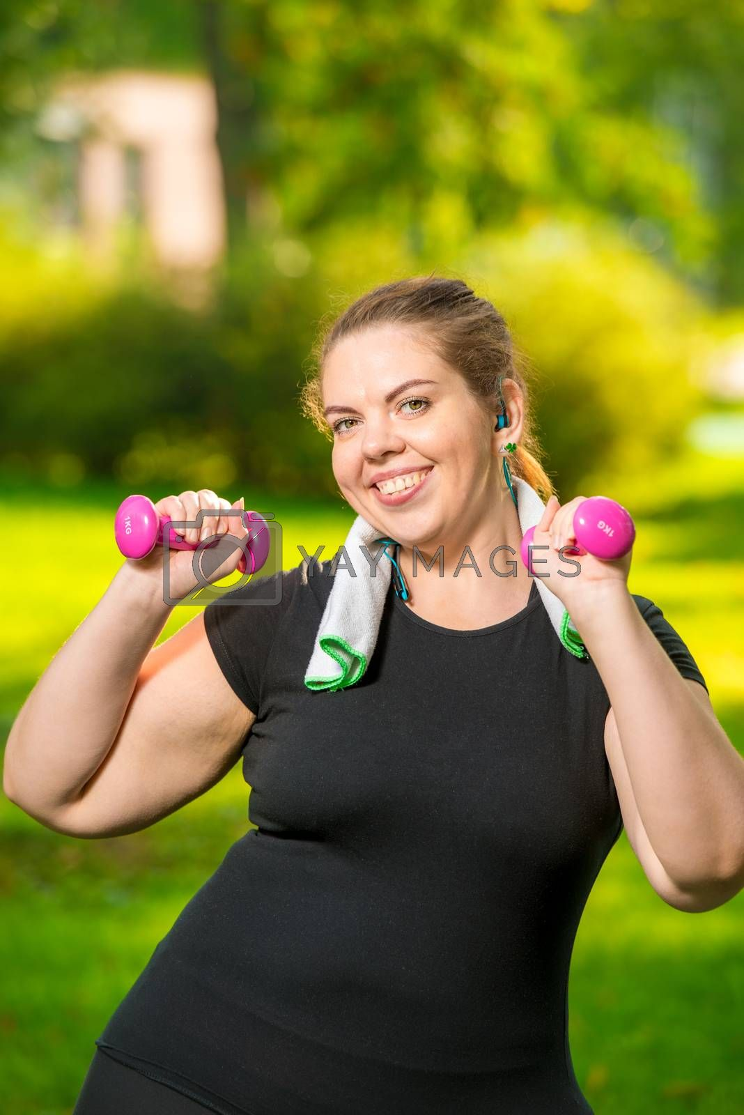 oversize woman in headphones with dumbbells in hand playing spor by Labunskiy K.