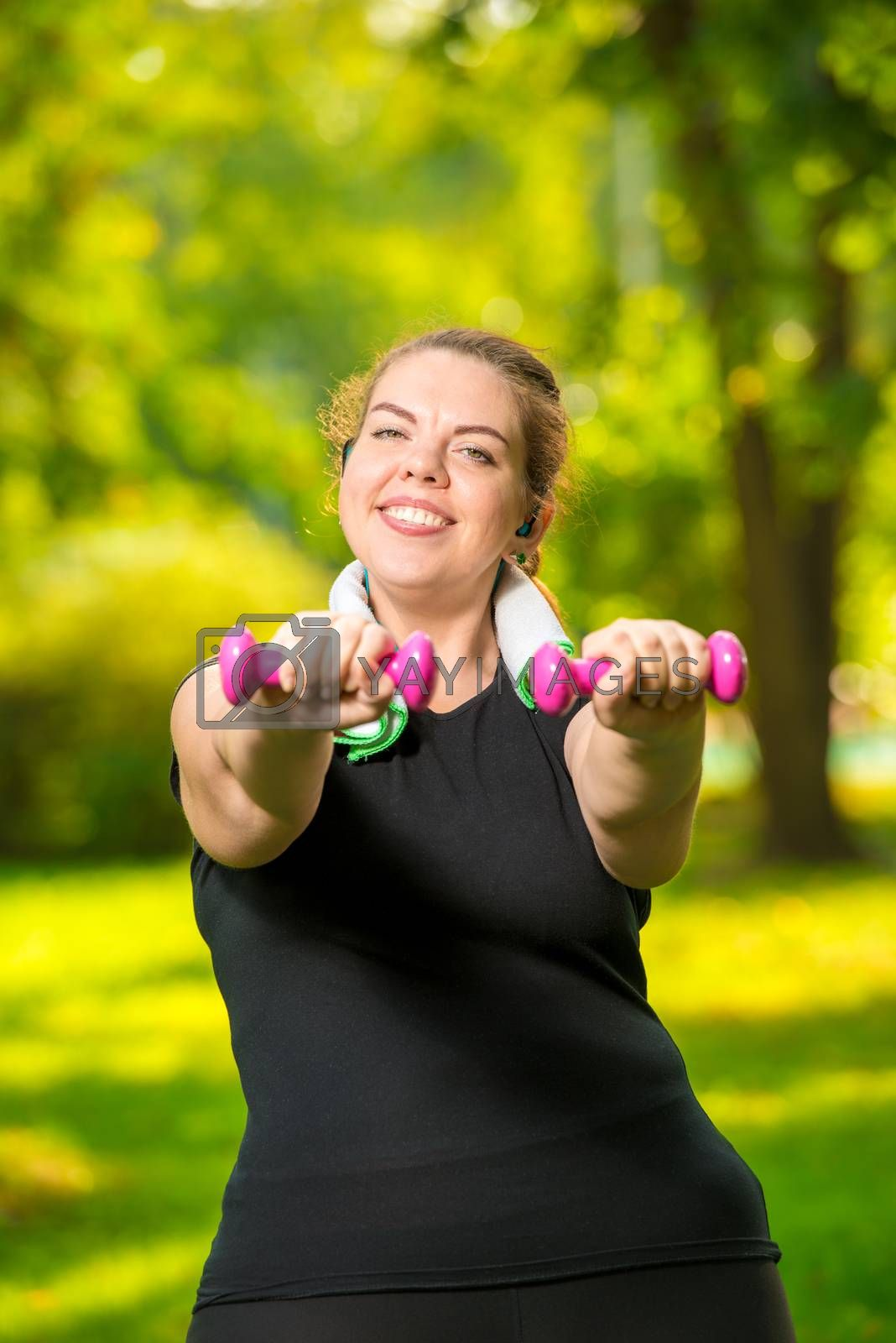 overweight woman doing her exercise in the park, exercise with d by Labunskiy K.