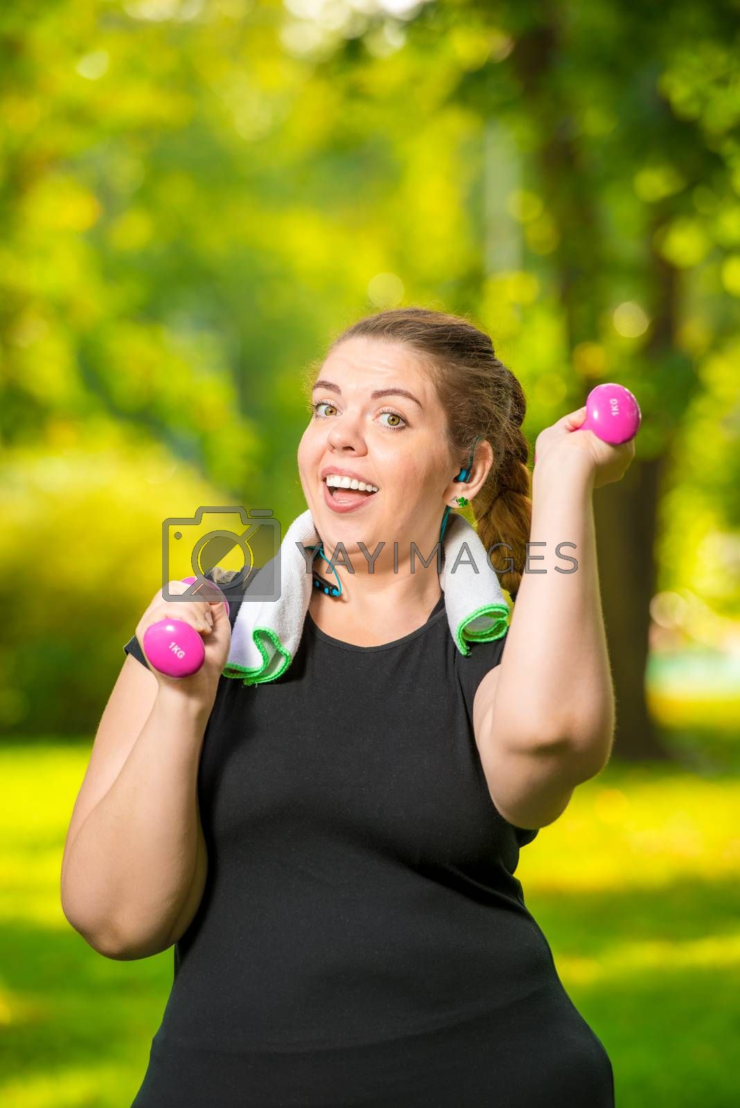 happy fat woman doing her exercise in the park, exercise with du by Labunskiy K.
