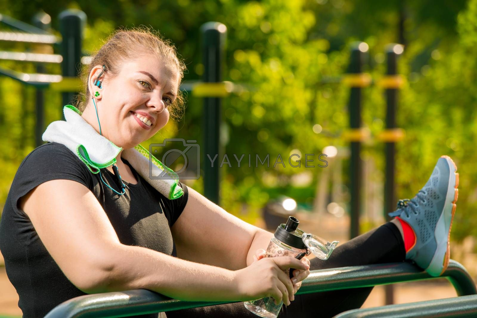 flexible plus size woman engaged with a port on the playground i by Labunskiy K.