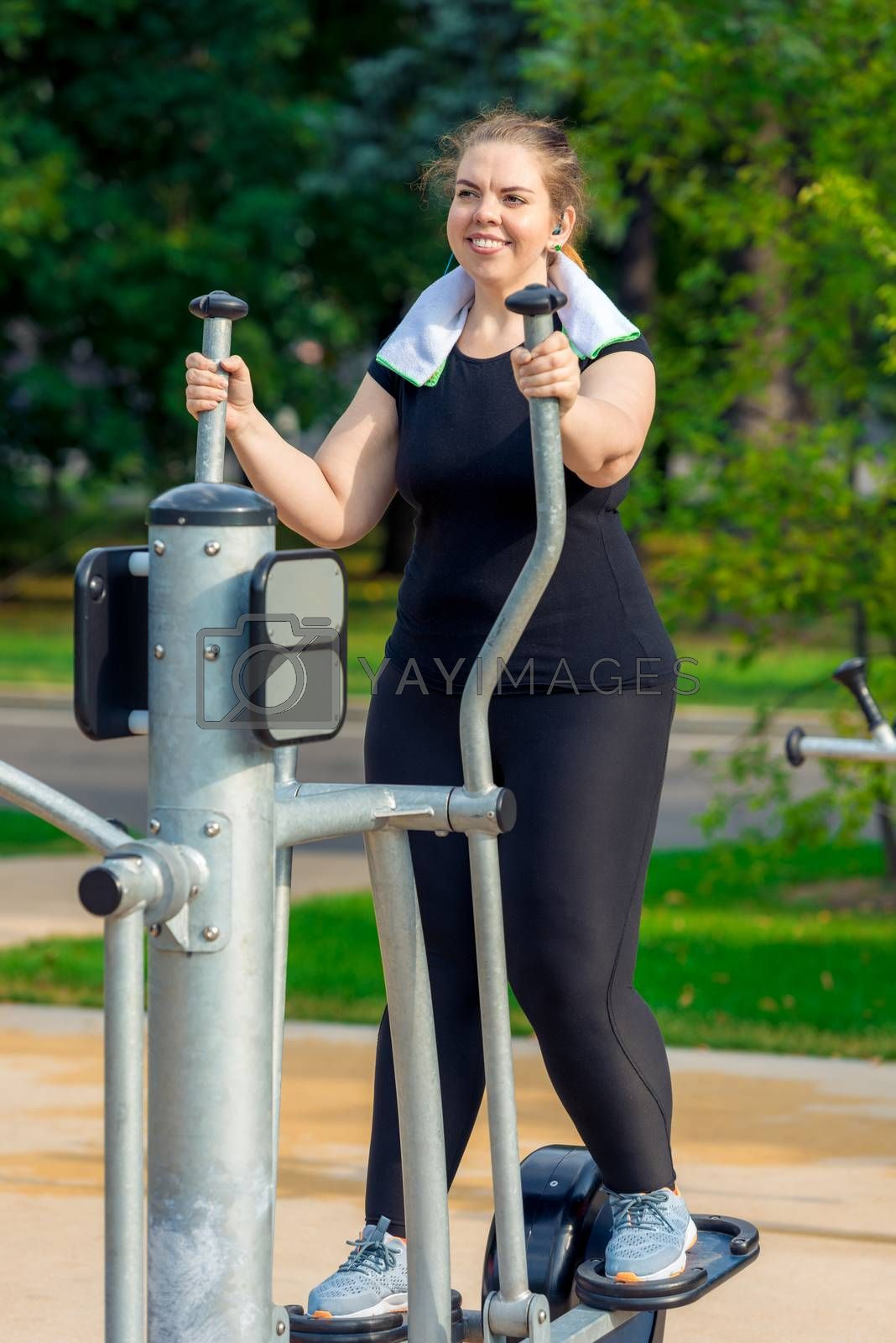 portrait of an active fat woman without complexes is engaged on  by Labunskiy K.