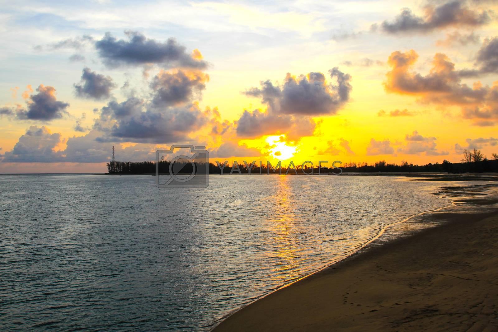 Sunset Sky on tropical beach in Phuket ,Thailand. by Nunnicha Supagrit
