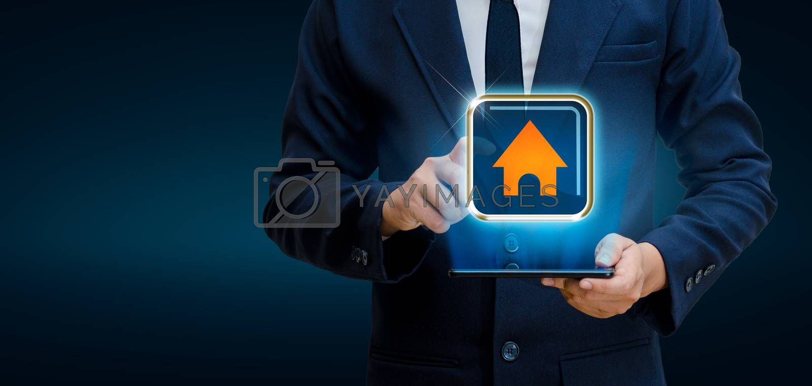 The house is in the hands of the businessman  home icon or symbol by Sarayut