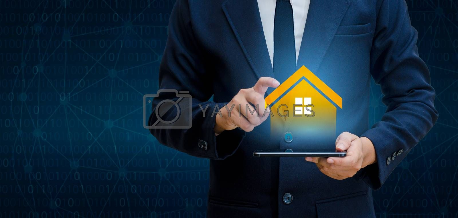 The house is in the hands of the business man  home icon or symbol by Sarayut