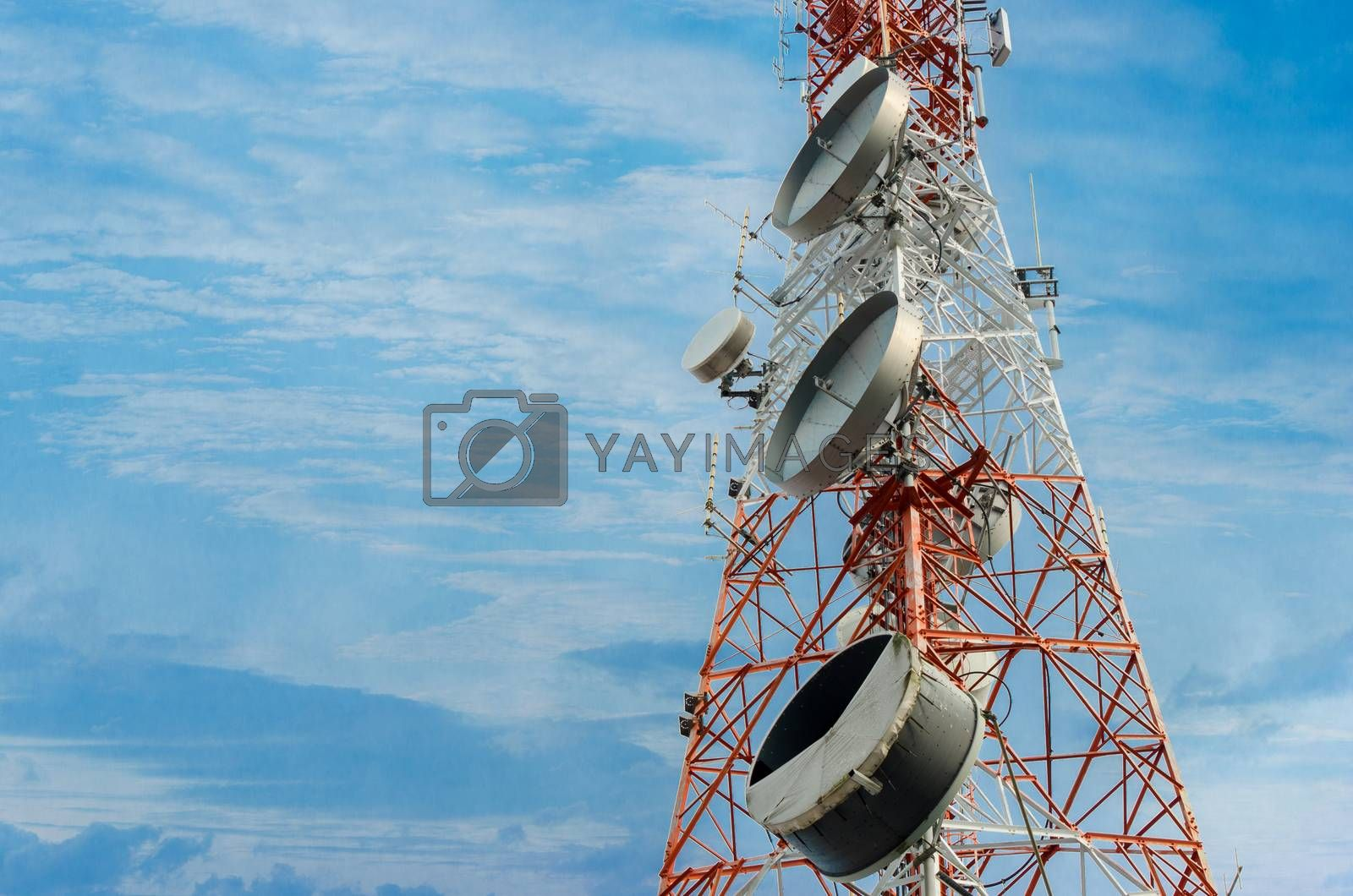 Telecommunication tower antenna In the clear sky by Sarayut
