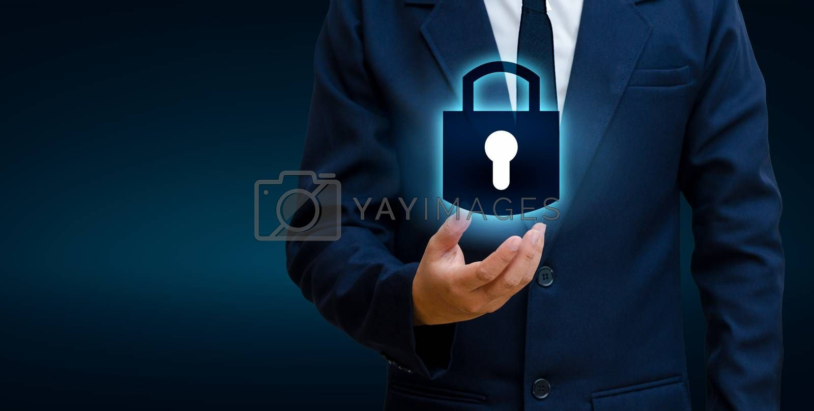 lock In the hands of a businessman Shield the shield to protect the cyberspace.Space input data Data Security Business Internet Concept. Secure information by Sarayut