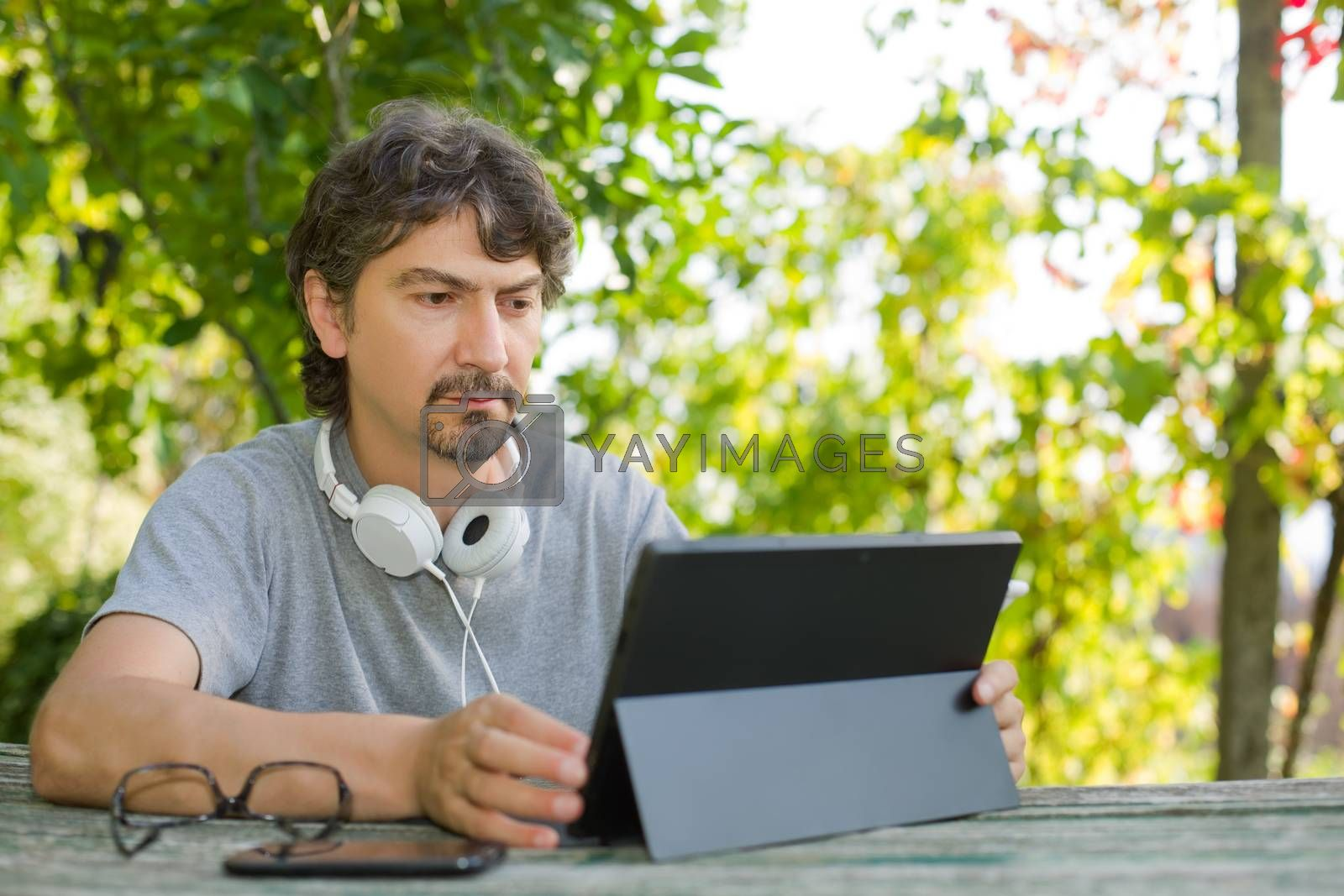 man with tablet by zittto
