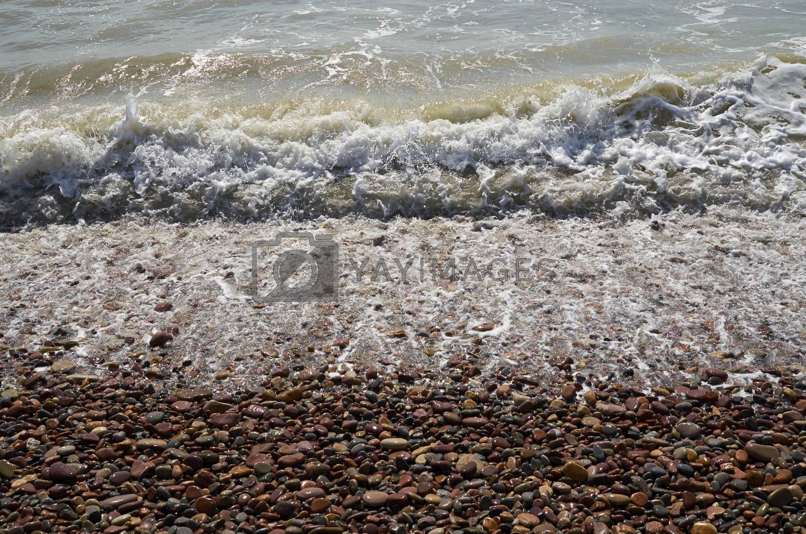 Detail of waves reaching the shore of the beach