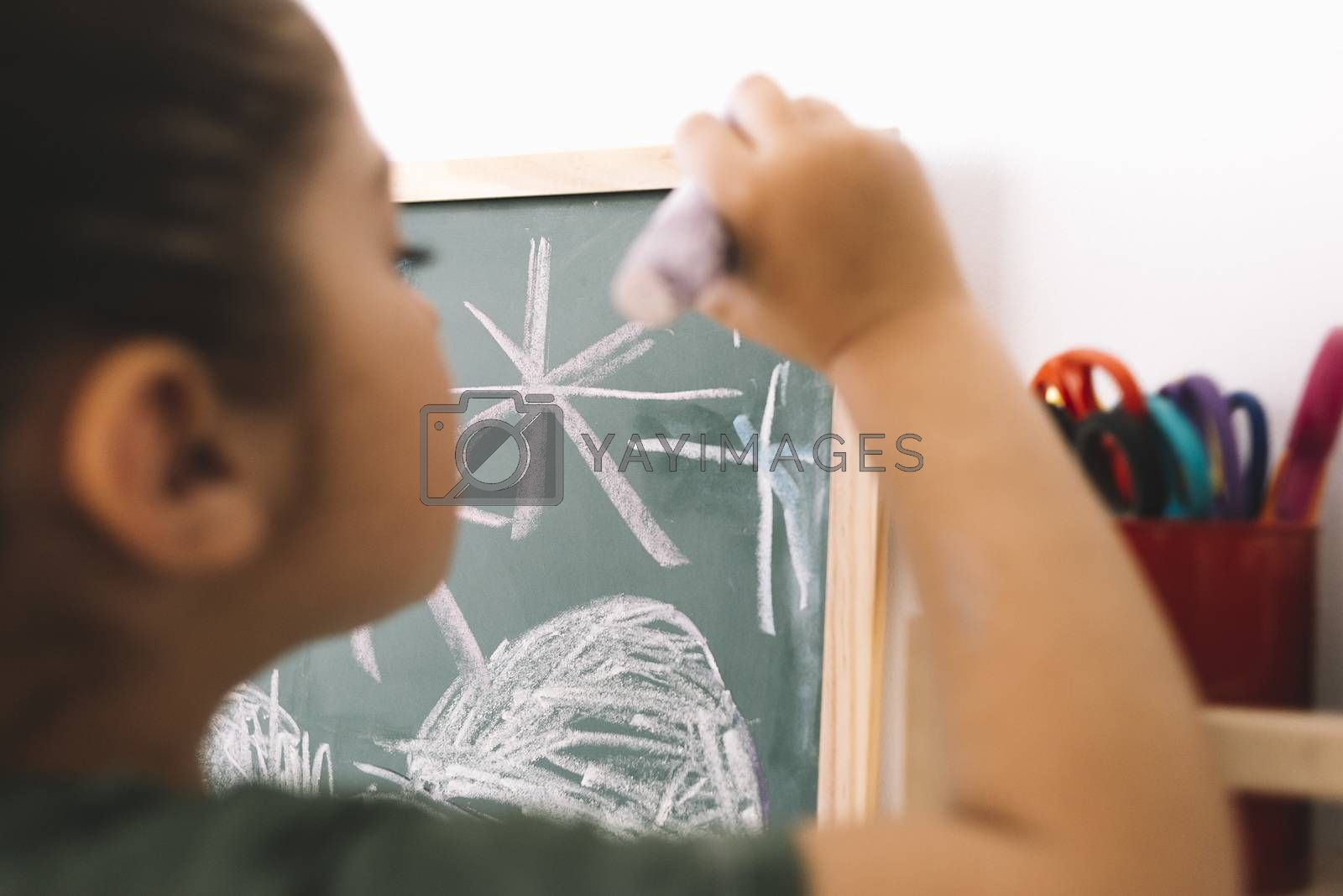 little girl drawing on a chalkboard by raulmellado