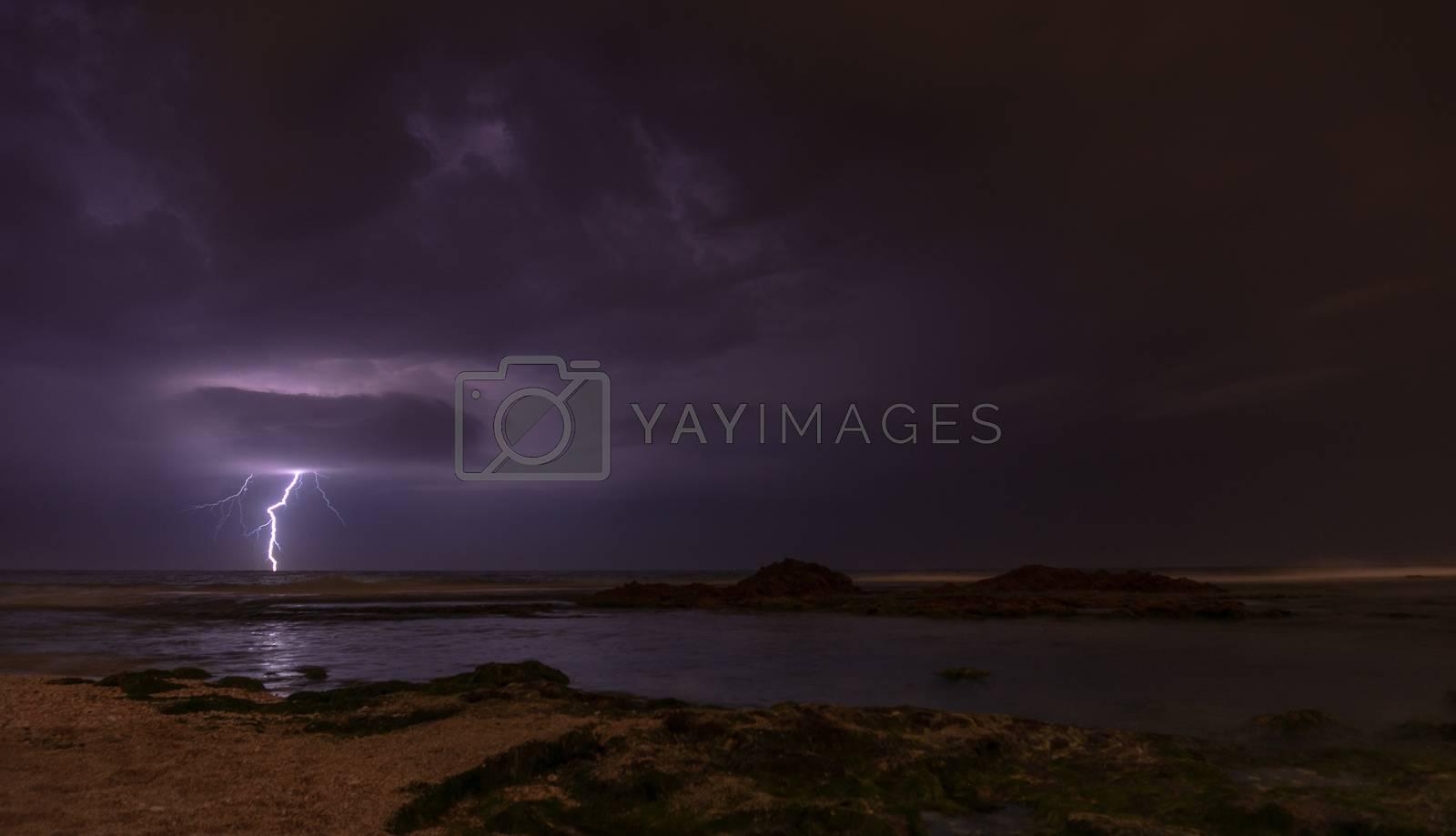 Thunderstorm on mediterranean sea beach by javax