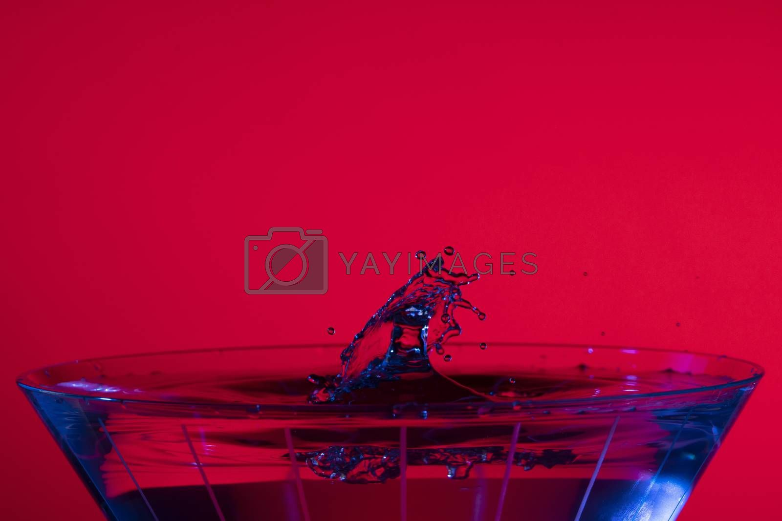Blue Martini Splashes on Red by Charlie Floyd