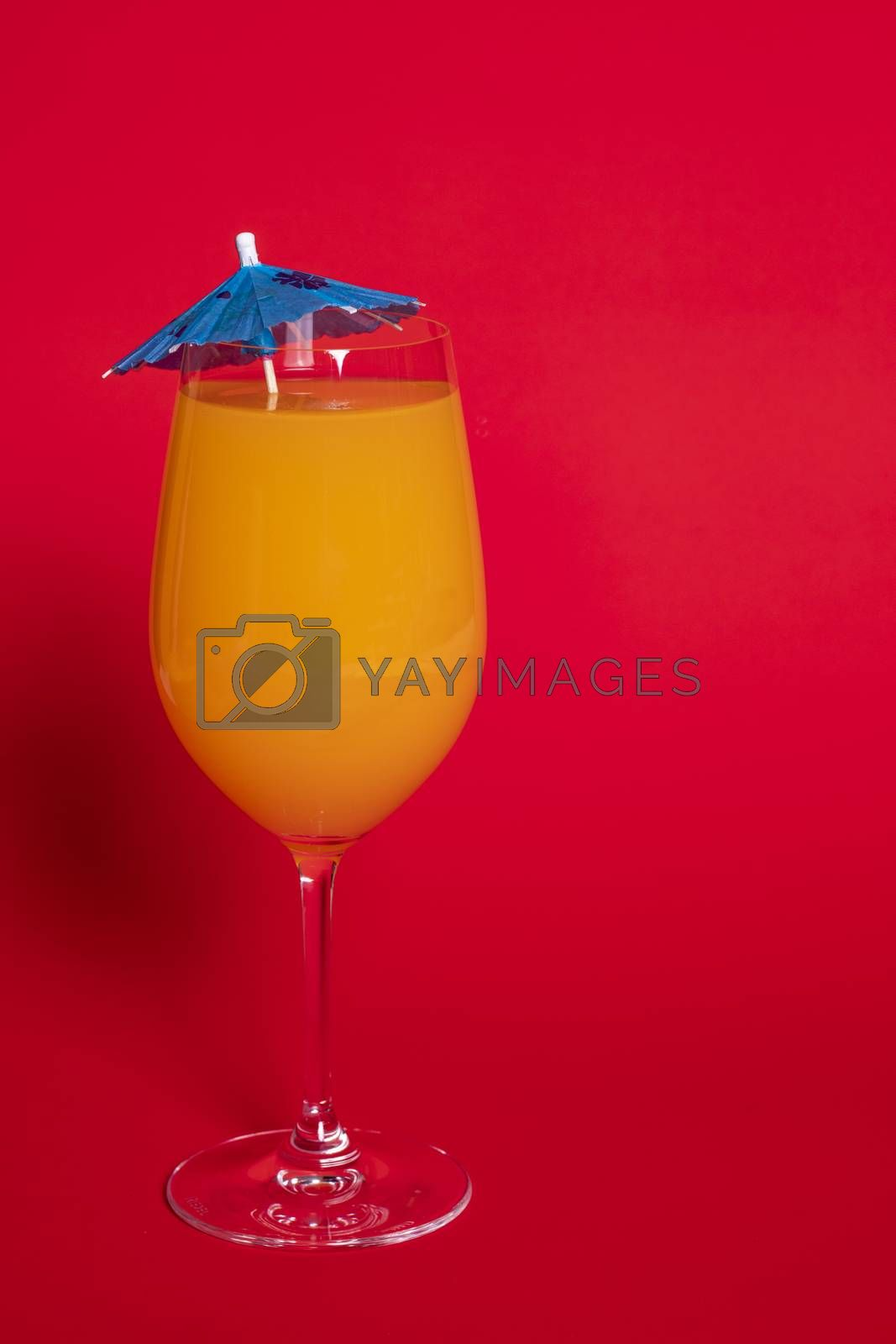 Orange Drink in Wine Glass Against Red I by Charlie Floyd
