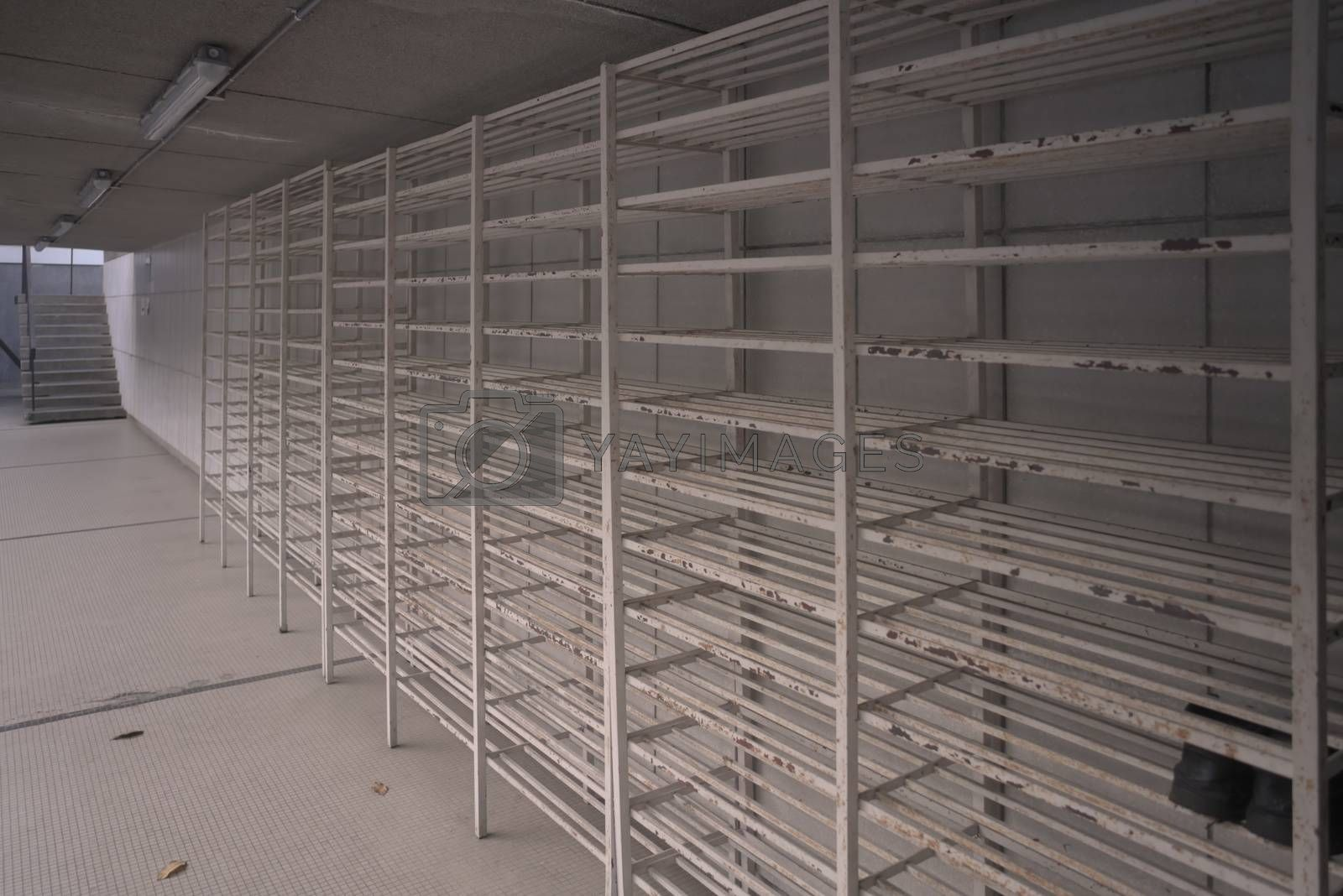 empty white metal bars shoes rack storage at the mosque taken from the side