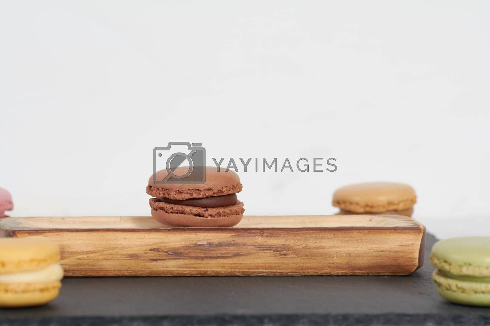 Royalty free image of breakfast of macarons wooden splint by Prf_photo
