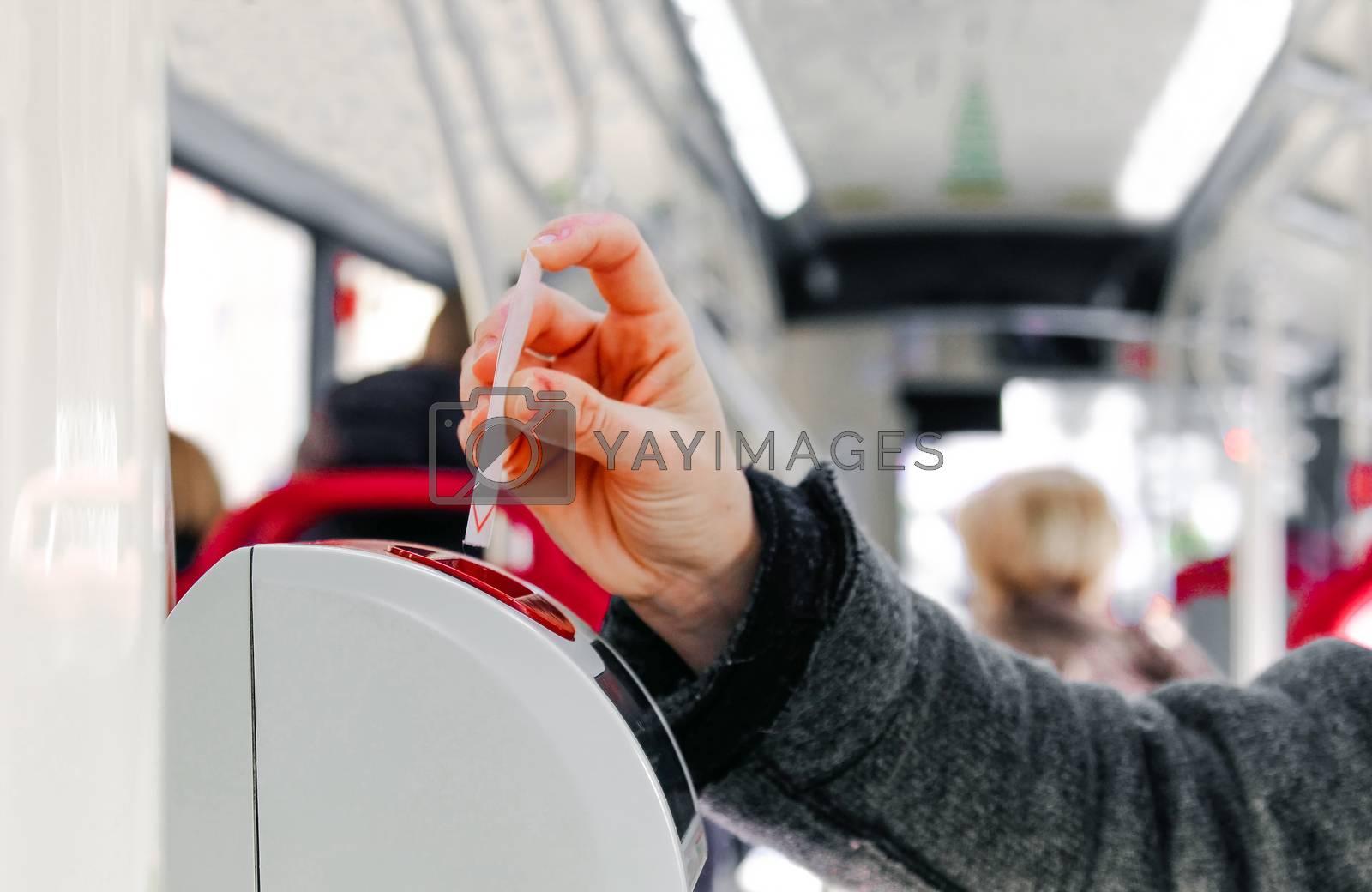 bus ticket insert in validator hand background