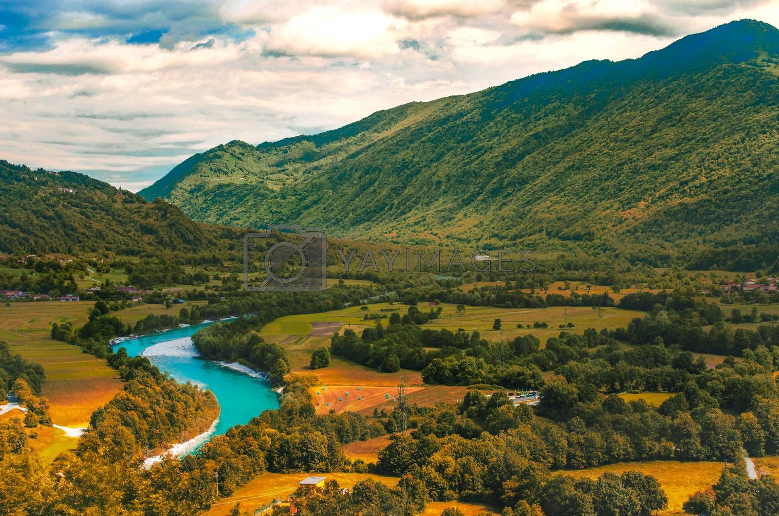 Isonzo Soca river valley  yellow teal and orange sunset landscape in  Slovenia - Italy border .